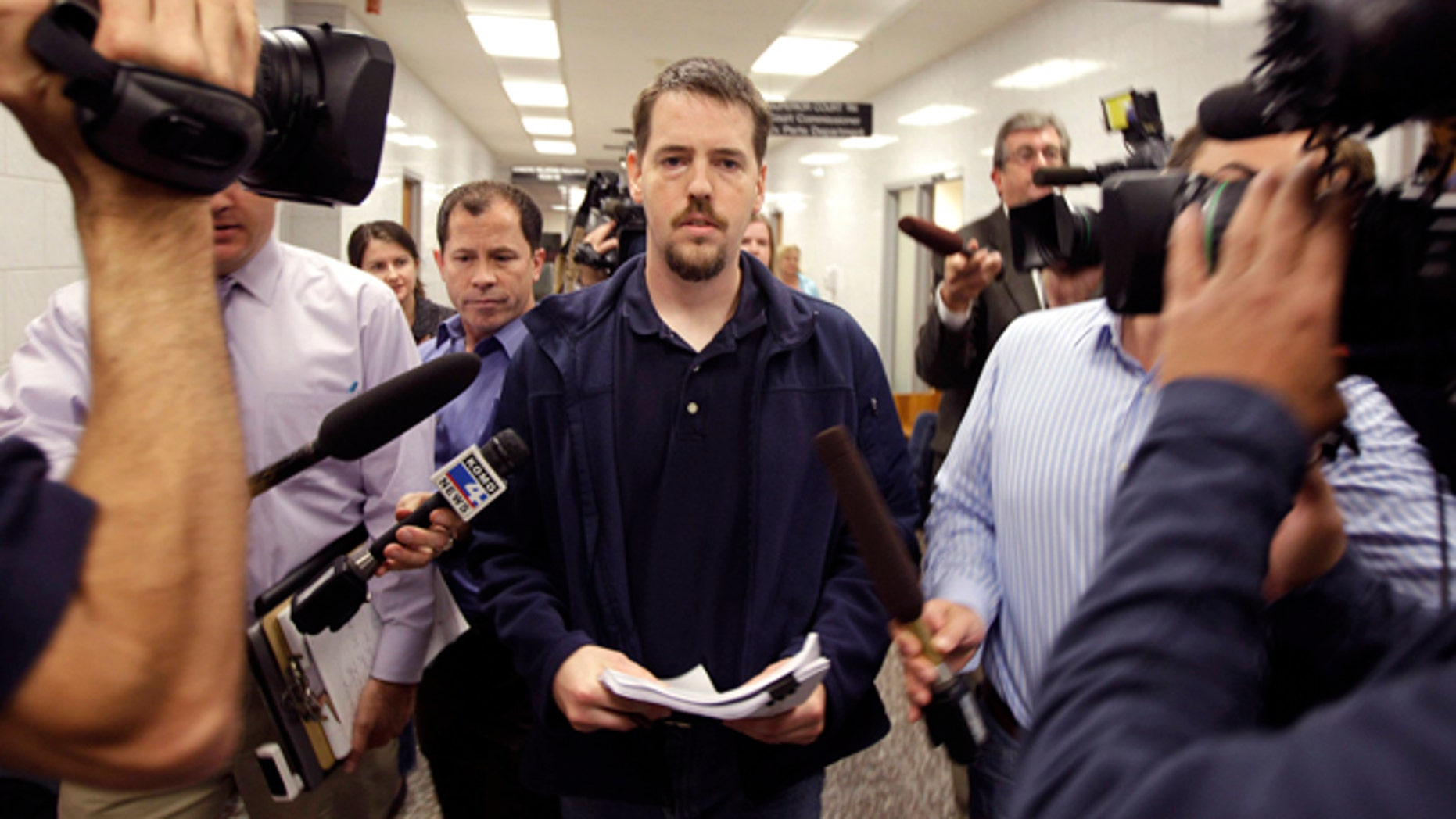 FILE - In this Sept. 23, 2011, file photo, Josh Powell, the husband of missing Utah woman Susan Powell, is surrounded by reporters as he leaves a Pierce County courtroom in Tacoma, Wash. FBI documents say investigators found child pornography on Powell's computer at least 17 months before he killed his children and himself. (AP Photo/Ted S. Warren, File)