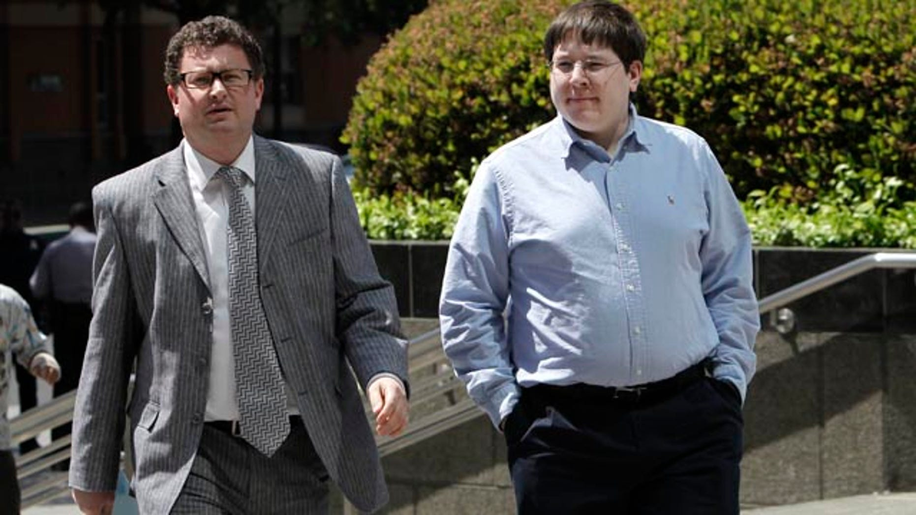 FILE -- In this April 23, 2013 file photo, Matthew Keys, right, who faces federal charges that he allegedly conspired with the hacking group Anonymous to break into the Los Angeles Times' website, walks to the federal courthouse for his arraignment with his attorney Jason Leiderman, in Sacramento, Calif. (AP Photo/Rich Pedroncelli,file)