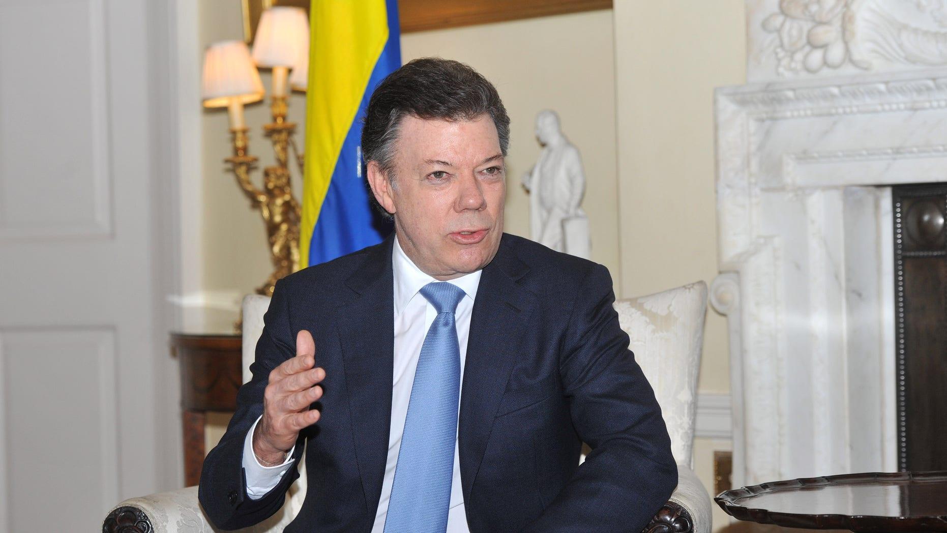 "Colombian President Juan Manuel Santos speaks to media on arrest of Daniel ""El Loco"" Barrera."