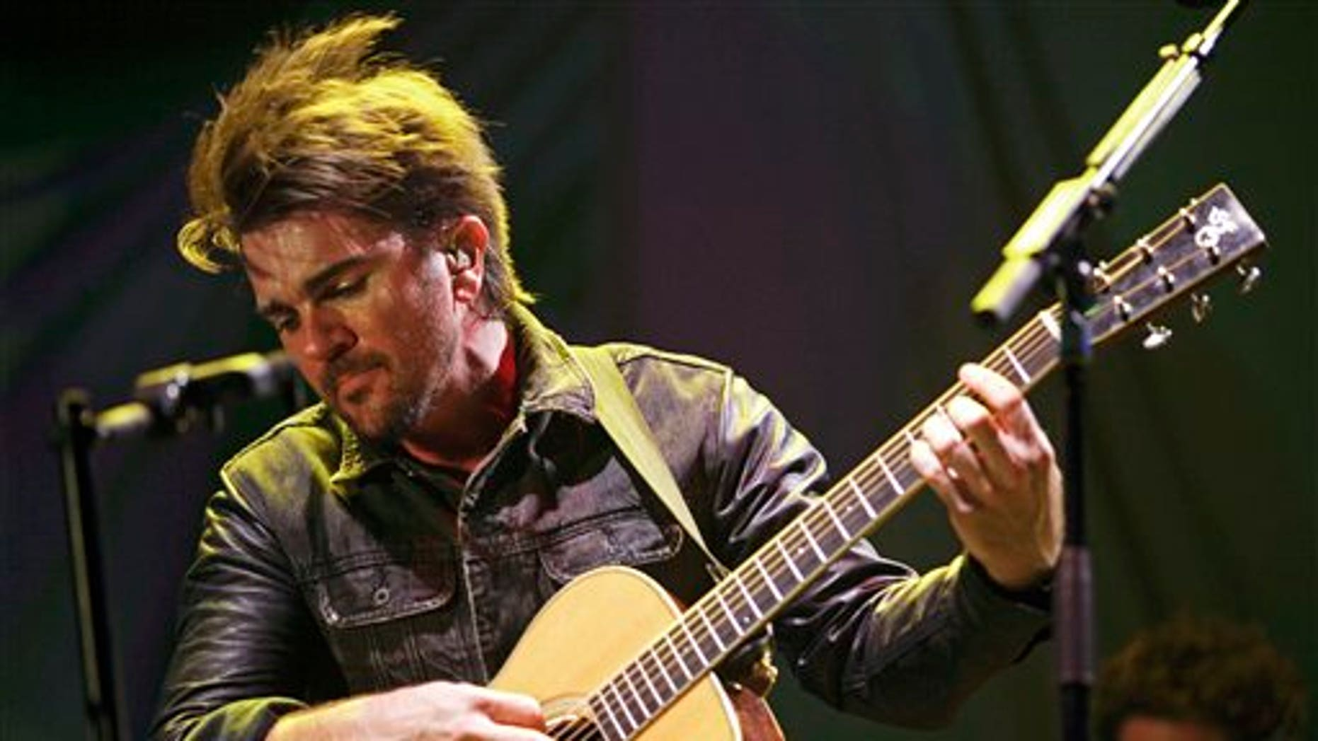 FILE - In this April 18, 2013 file photo, Colombian singer Juanes performs in a concert as a part of his Unplugged tour in Panama City. Juanes will launch his album Loco de Amor, on March 11, 2014. The singer said that the album recorded in live studio sessions at a studio and produced by Steve Lillywhite, is his best work to date. (AP Photo/Arnulfo Franco, File)
