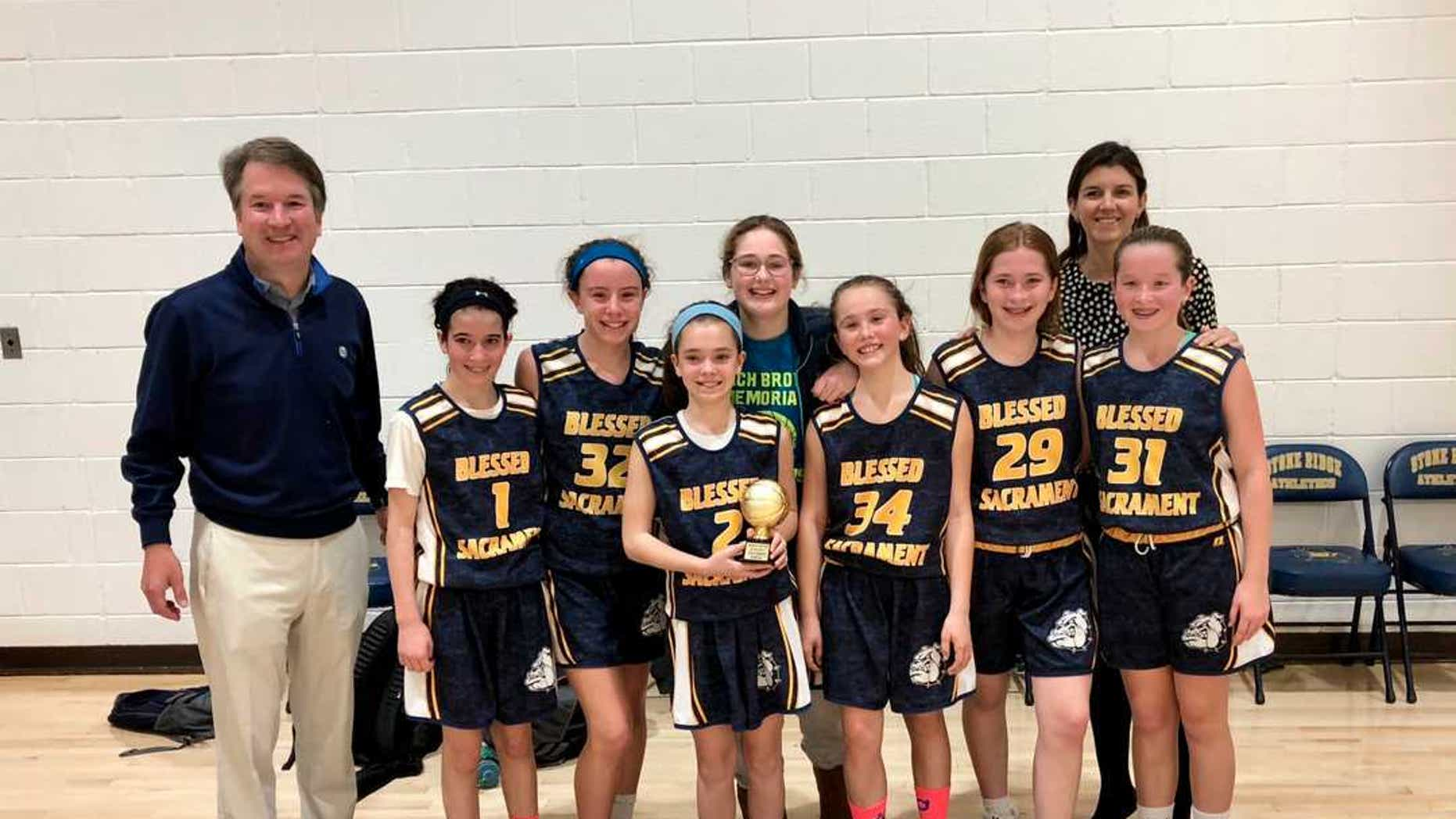 Judge Brett Kavanaugh with his daughter's basketball team, which he coaches.