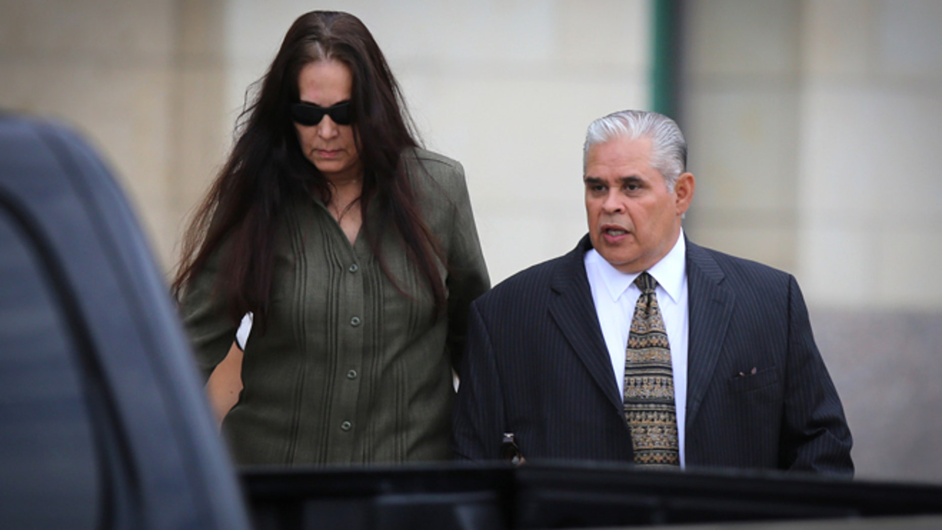 Aug 21, 2013: Former 404th state District Judge Abel Limas, right, quickly exits the federal courthouse in Brownsville, Texas.