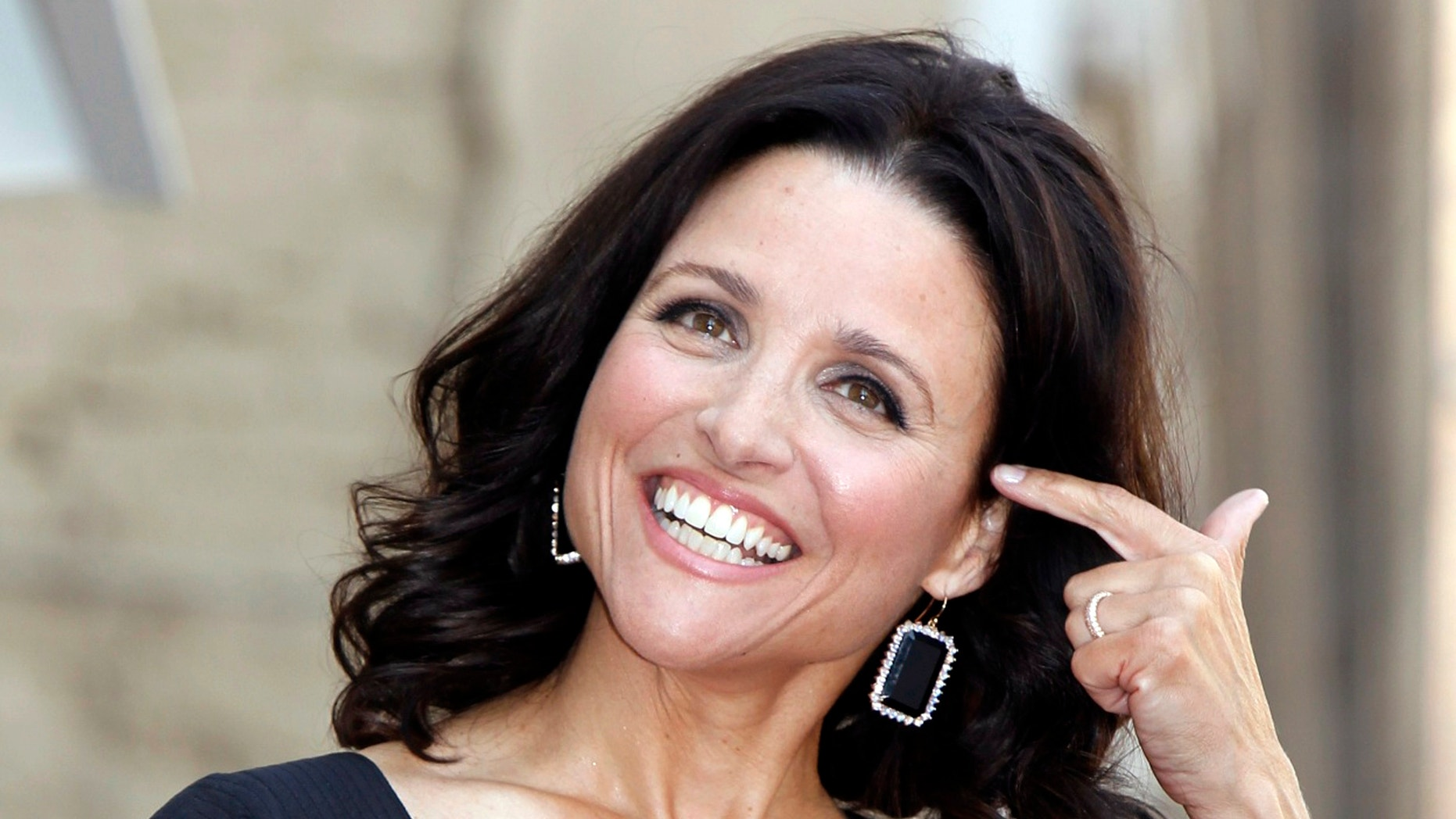 Actress Julia Louis-Dreyfus attends a ceremony to unveil her star on the Hollywood Walk of Fame in Hollywood, California May 4, 2010.
