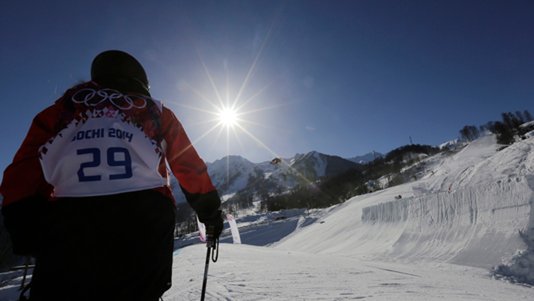 Paraguay's Julia Marino watches other competitors during a Ski Slopestyle training session at the Rosa Khutor Extreme Park, prior to the 2014 Winter Olympics, Tuesday, Feb. 4, 2014, in Krasnaya Polyana, Russia. (AP Photo/Andy Wong)