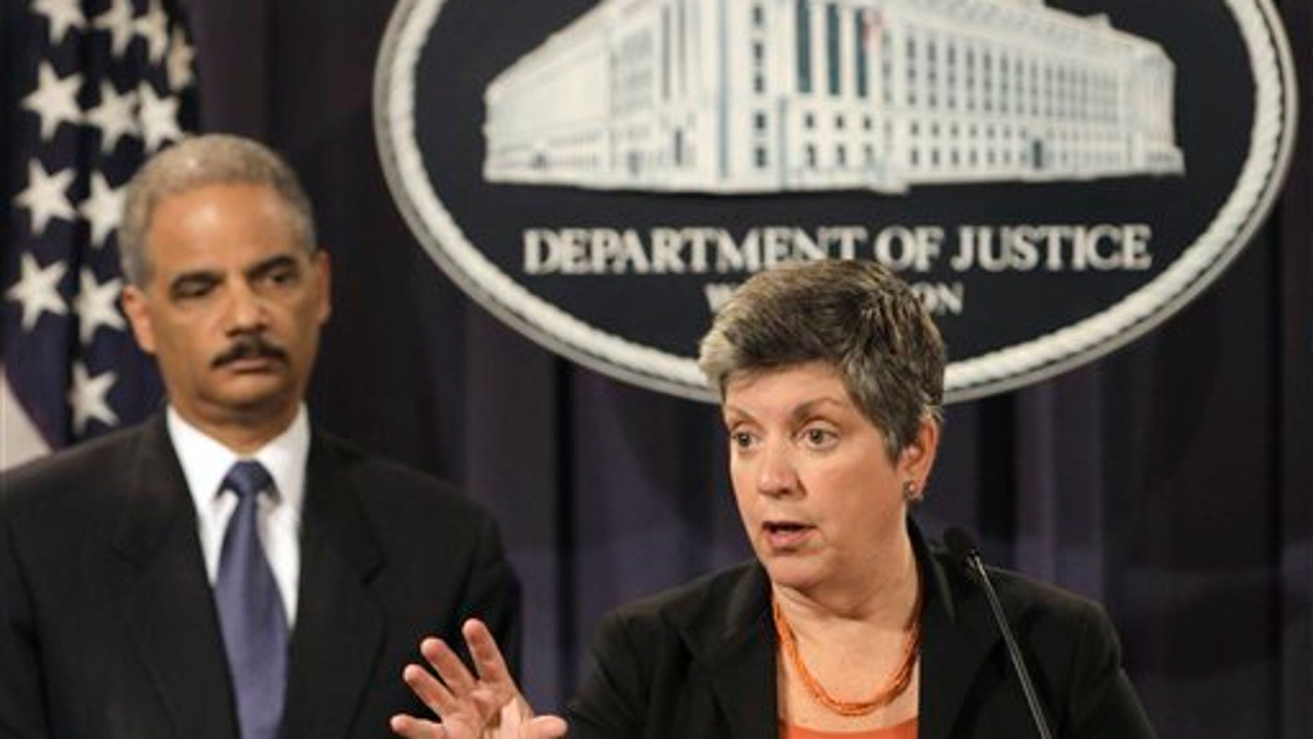 Aug. 3: Attorney General Eric Holder listens at left as Homeland Security Secretary Janet Napolitano speaks at the Justice in Washington, to discuss the results of the largest U.S. prosecution of an international criminal network organized to sexually exploit children.