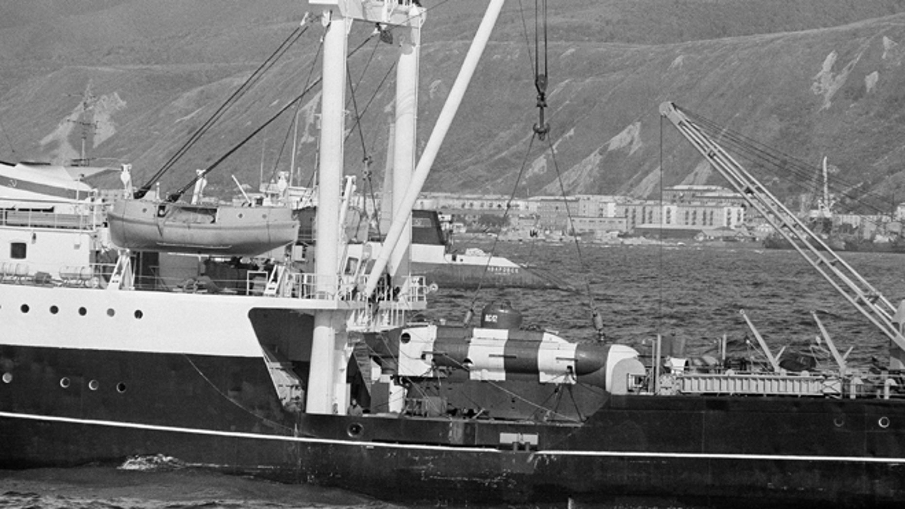 Sept. 27, 1983: A Soviet mini-submarine used to search for debris from Korean Air Lines Flight 007, shot down Sept. 1, 1983 near Sakhalin Island, rests on the deck of a conventional tender vessel in Nevel'sk, Sakhalin Island, in the East Sea off Russia.