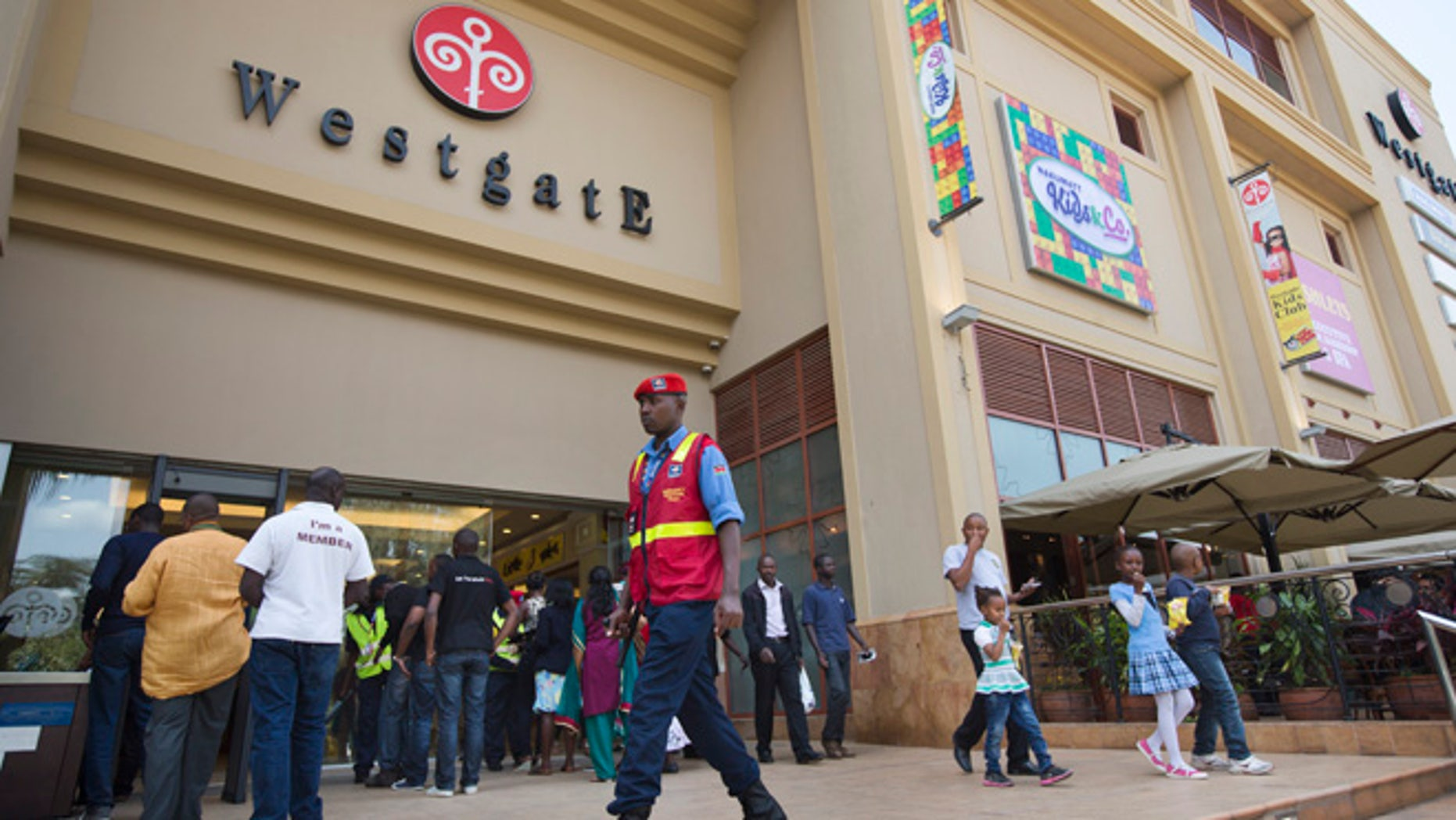 A security guard patrols outside the reopened Westgate Shopping Mall, nearly two years after a terrorist attack there left at least 67 people dead, in the capital Nairobi, Kenya Saturday, July 18, 2015. Hundreds of shoppers thronged through the reopened mall Saturday, following two years of repairs after security forces battled four gunmen from Somalia's al-Qaida-linked al-Shabab militant group there in September 2013. (AP Photo/Ben Curtis)