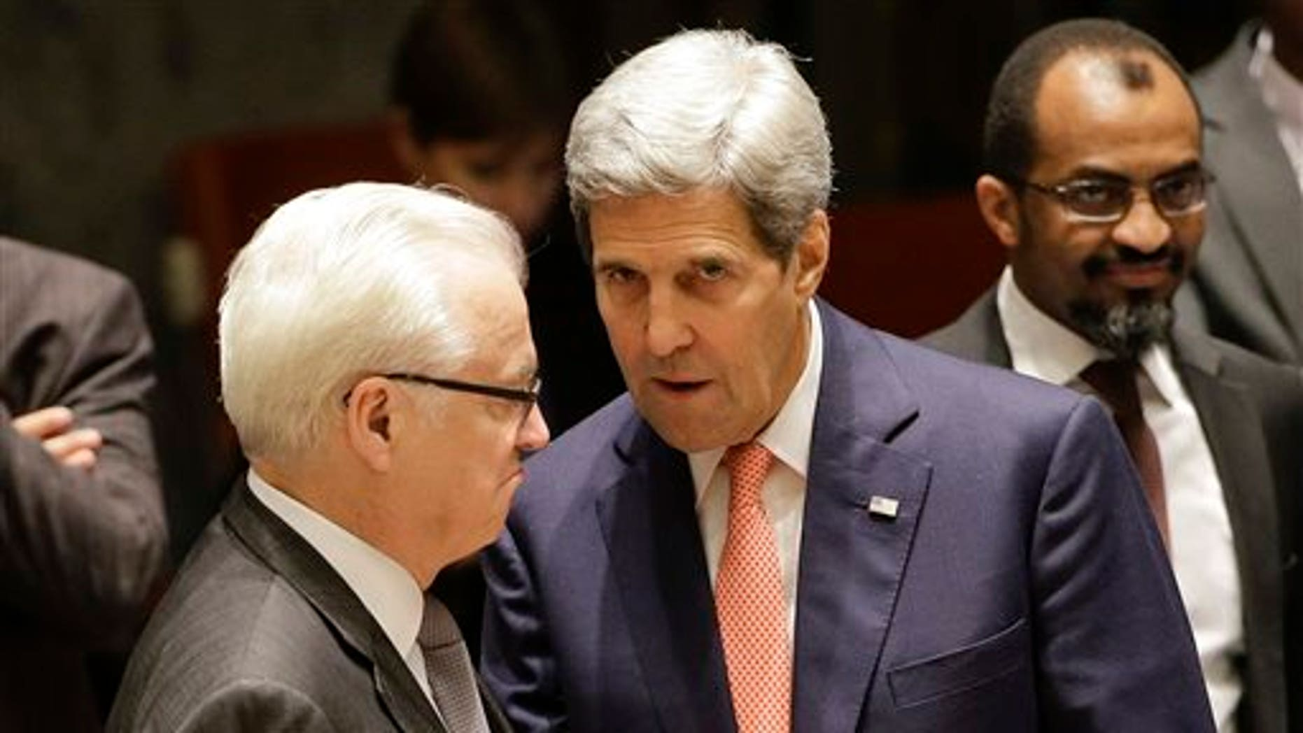 U.S. Secretary of State John Kerry, right, talks with Vitaly Churkin, Russian permanent resident to the United Nations, before a meeting of the U.N. Security Council, Friday, Sept. 19, 2014, at United Nations headquarters. The security council met Friday to discuss the situation in Iraq. (AP Photo/Julie Jacobson)