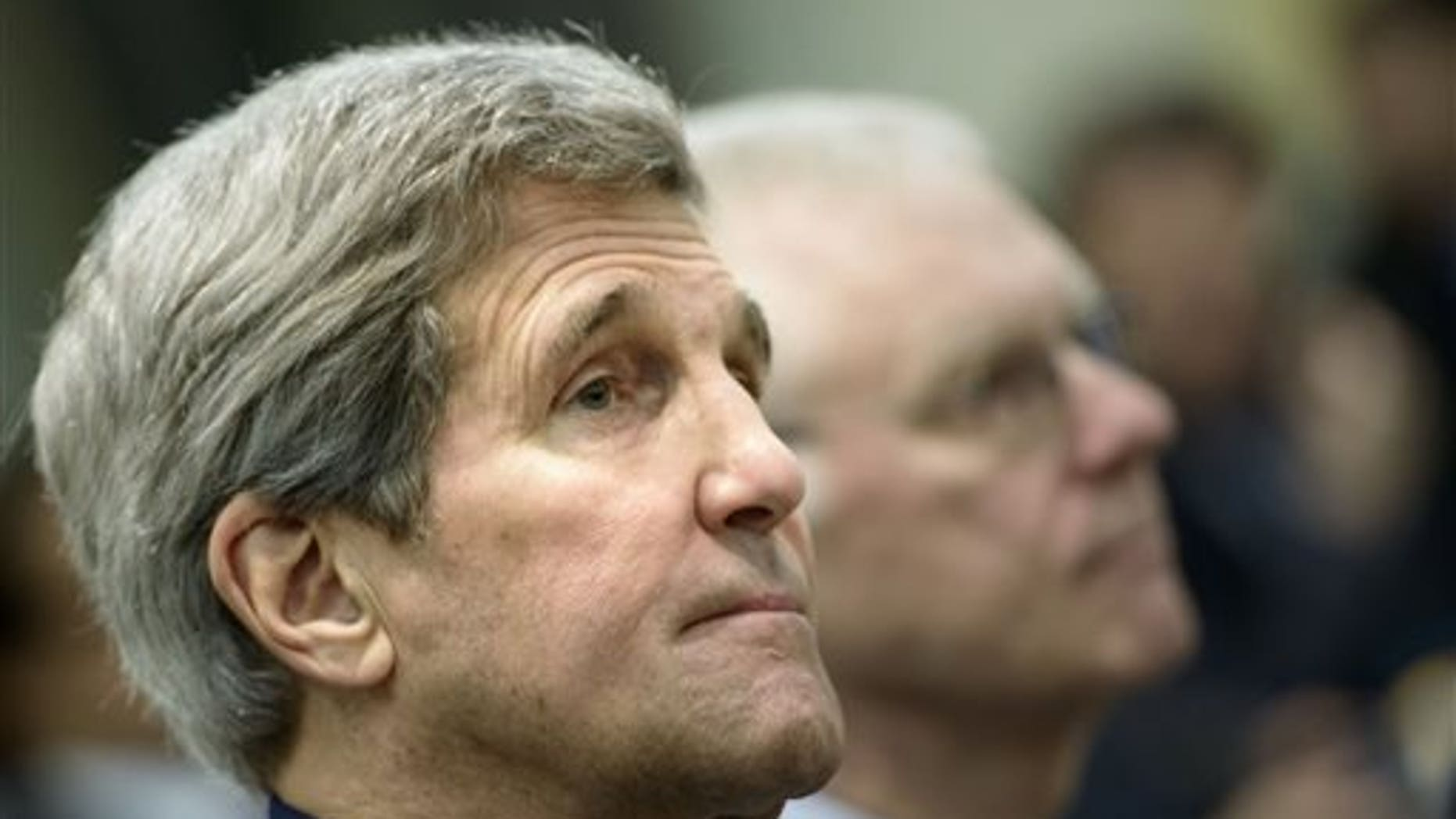 U.S. Secretary of State John Kerry waits for the start of a meeting on Iran's nuclear program with officials from Britain, France, Germany, China, the European Union and Iran in Lausanne, Switzerland Tuesday, March 31, 2015. (AP Photo/Brendan Smialowski, Pool)