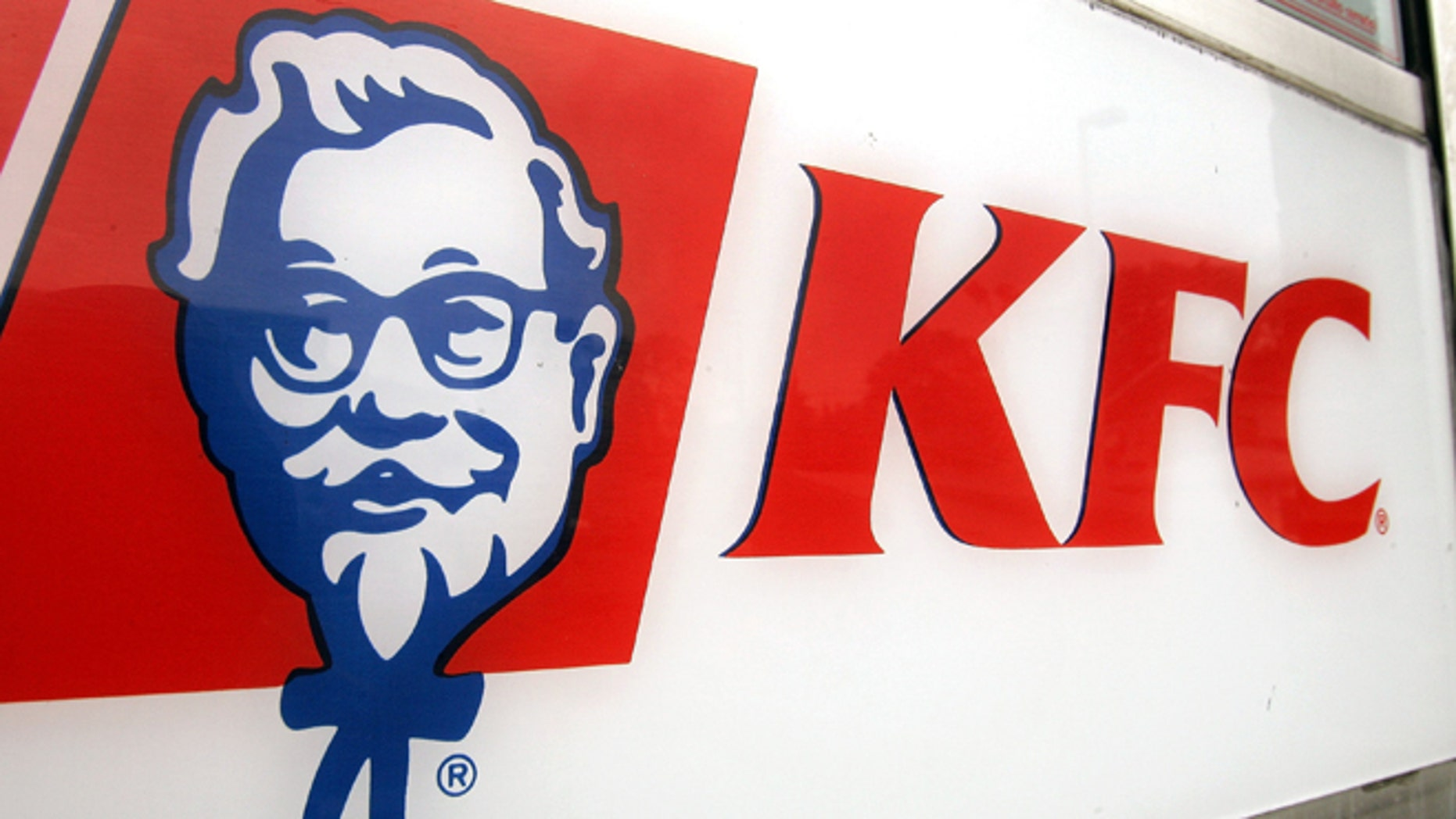 """CHICAGO - AUGUST 15: KFC signage is visible on a door of a cigarette-smoke-free company-owned KFC restaurant August 15, 2005 in Chicago, Illinois. Louisville, Kentucky-based Yum! Brands' company-owned 1,200 KFC and 1,675 Pizza Hut restaurants starting this week will be enacting a no smoking policy, placing """"No Smoking"""" signs in their US restaurants owned by the company. The company is encouraging their other 4,200 KFC and 4,600 Pizza Hut franchised restaurants in the US to follow.  (Photo by Tim Boyle/Getty Images)"""