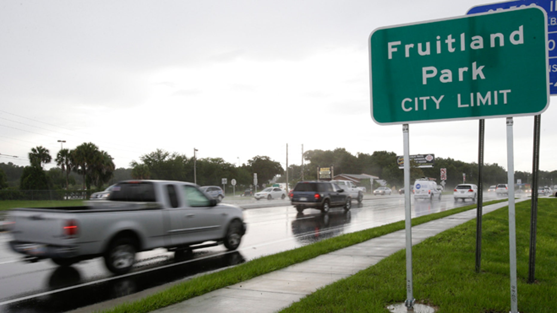 July 16, 2014: Cars pass by on a six lane highway that runs through Fruitland Park, Fla. Two police officers are no longer with the city department here after a law enforcement report tied them to the Ku Klux Klan. (AP/John Raoux)