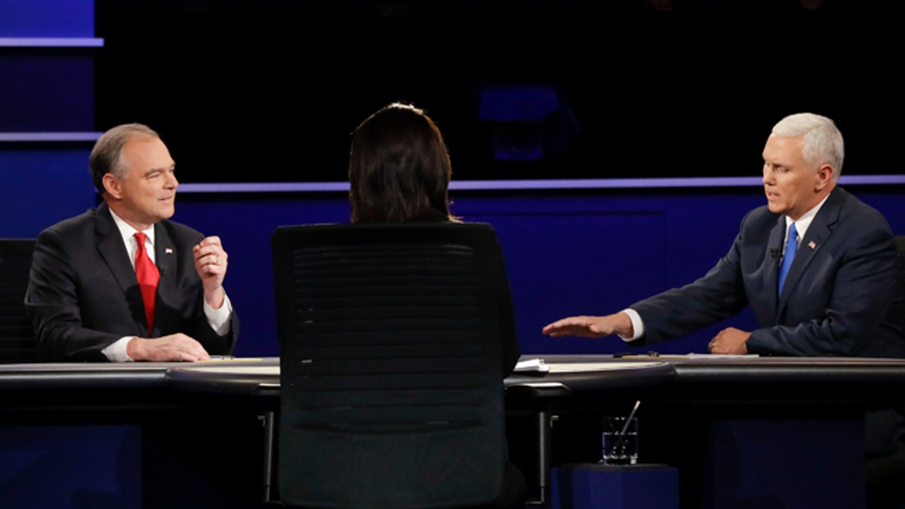 Republican vice-presidential nominee Gov. Mike Pence, right, and Democratic vice-presidential nominee Sen. Tim Kaine answer a question during the vice-presidential debate at Longwood University in Farmville, Va., Tuesday, Oct. 4, 2016. (AP Photo/David Goldman)