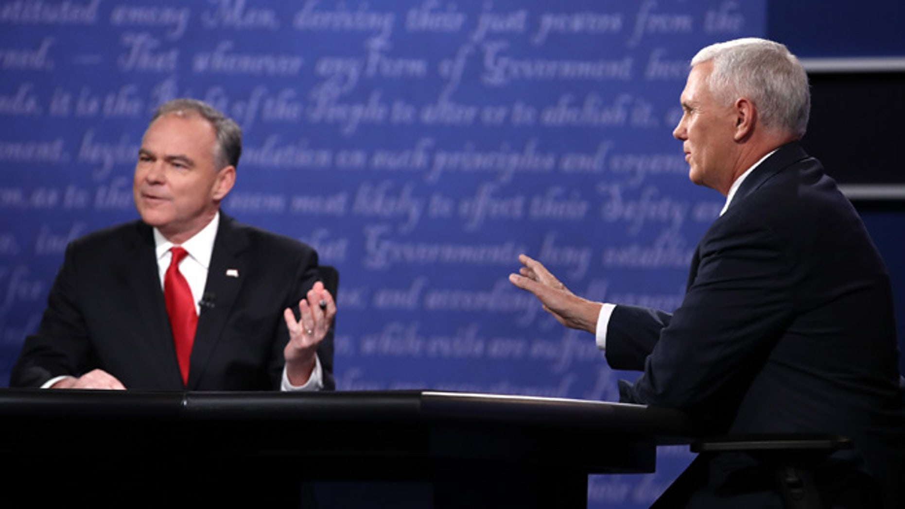Democratic vice presidential nominee Tim Kaine (L) and Republican vice presidential nominee Mike Pence (R) speak during the Vice Presidential Debate at Longwood University on October 4, 2016 in Farmville, Virginia.  This is the second of four debates during the presidential election season and the only debate between the vice presidential candidates.  (Photo by Win McNamee/Getty Images)