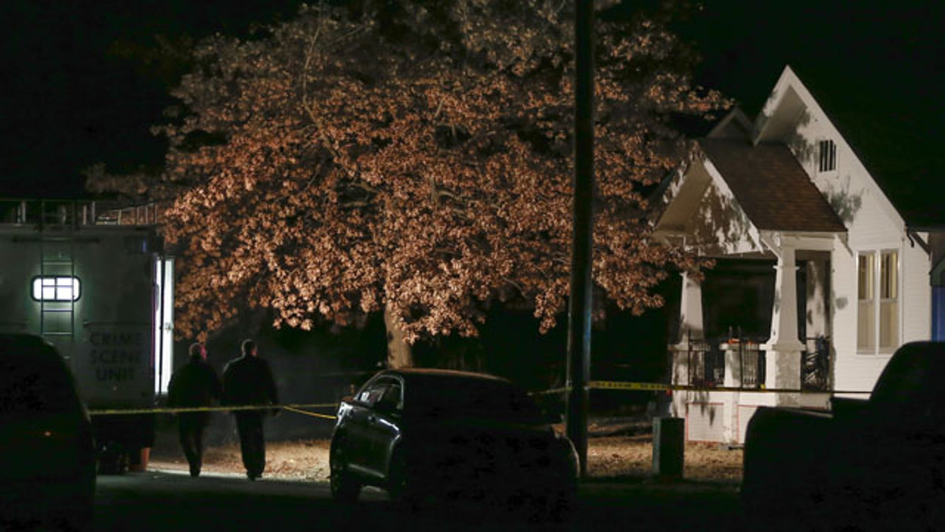 November 27, 2013: An active crime scene investigation is still underway in Parsons, Kan., where Cami Umbarger and her three young children – Hollie, Jaxon and Averie -- were found murdered in their home on Monday. (AP Photo/Wichita Eagle)