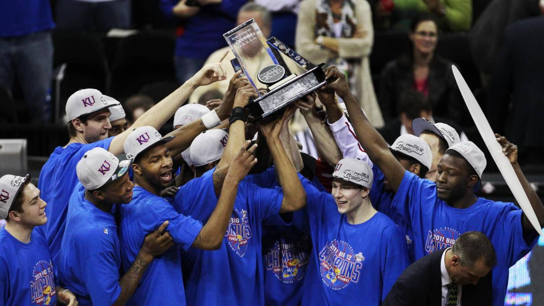 The Kansas Jayhawks celebrate winning the final of the Big 12 men's basketball tournament against Texas in Kansas City, Mo., Saturday, March 12, 2011. (AP Photo/Orlin Wagner)