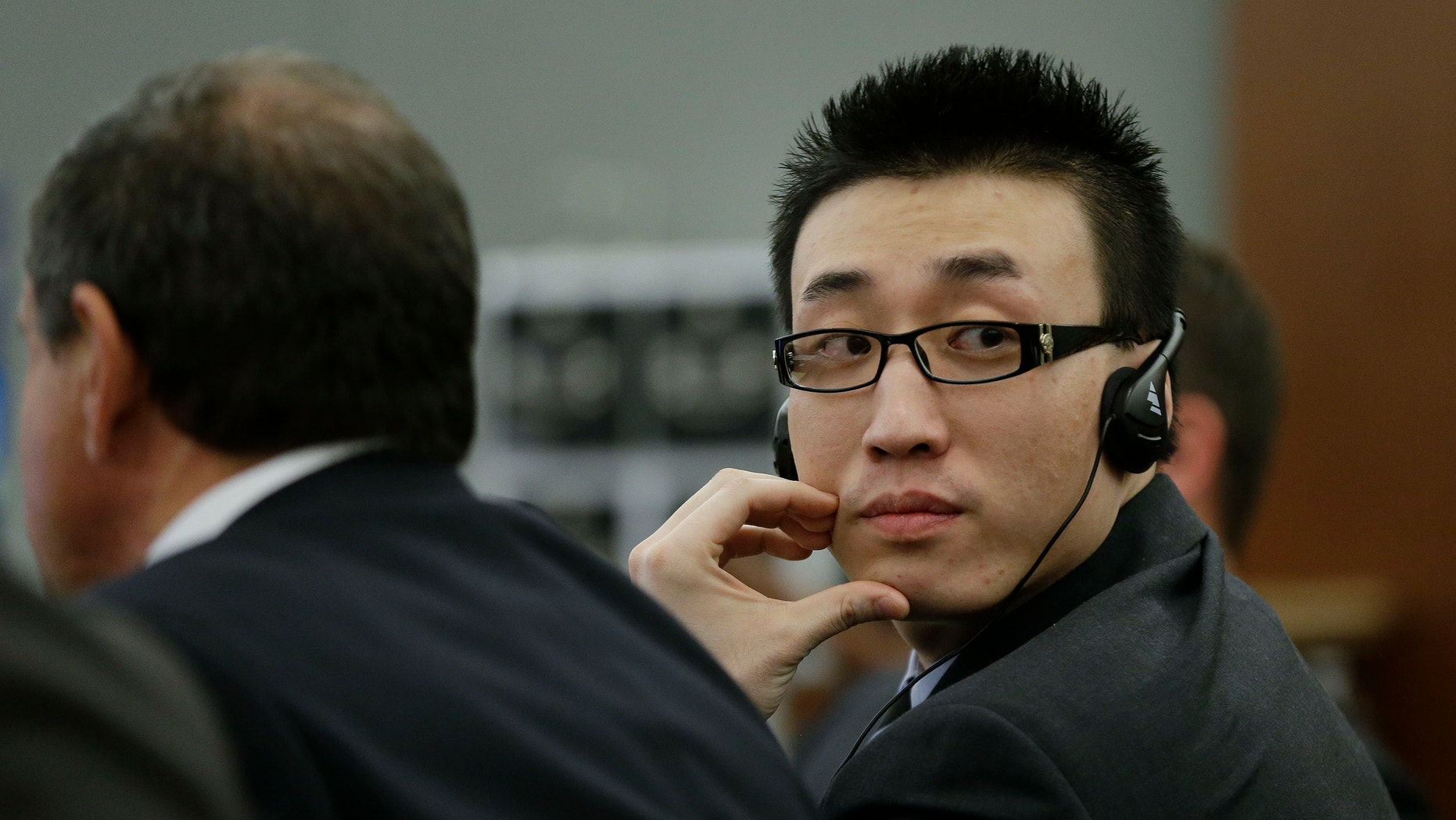 Nov. 28, 2012: Xiao Ye Bai listens in Clark County Court as  attorneys for the defense speak during arguments in his sentencing in this file photo taken in Las Vegas.
