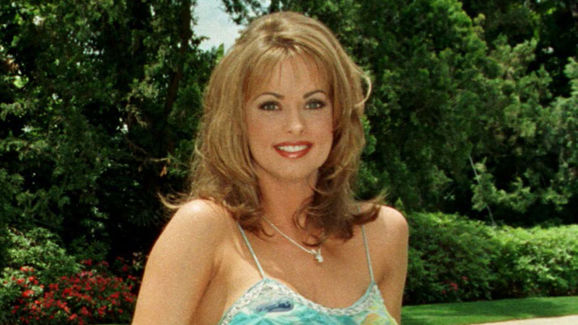 Karen McDougal poses after being named Playmate of the Year in 1998.