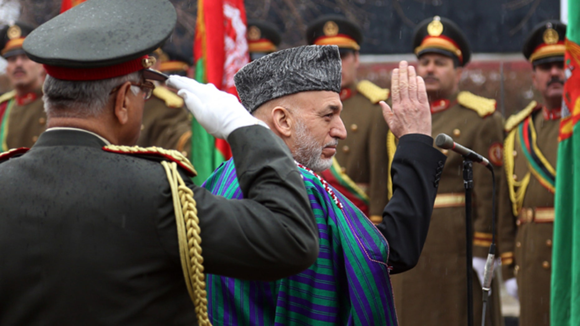 March 15: Afghan President Hamid Karzai arrives at an opening session at the parliament house in Kabul.