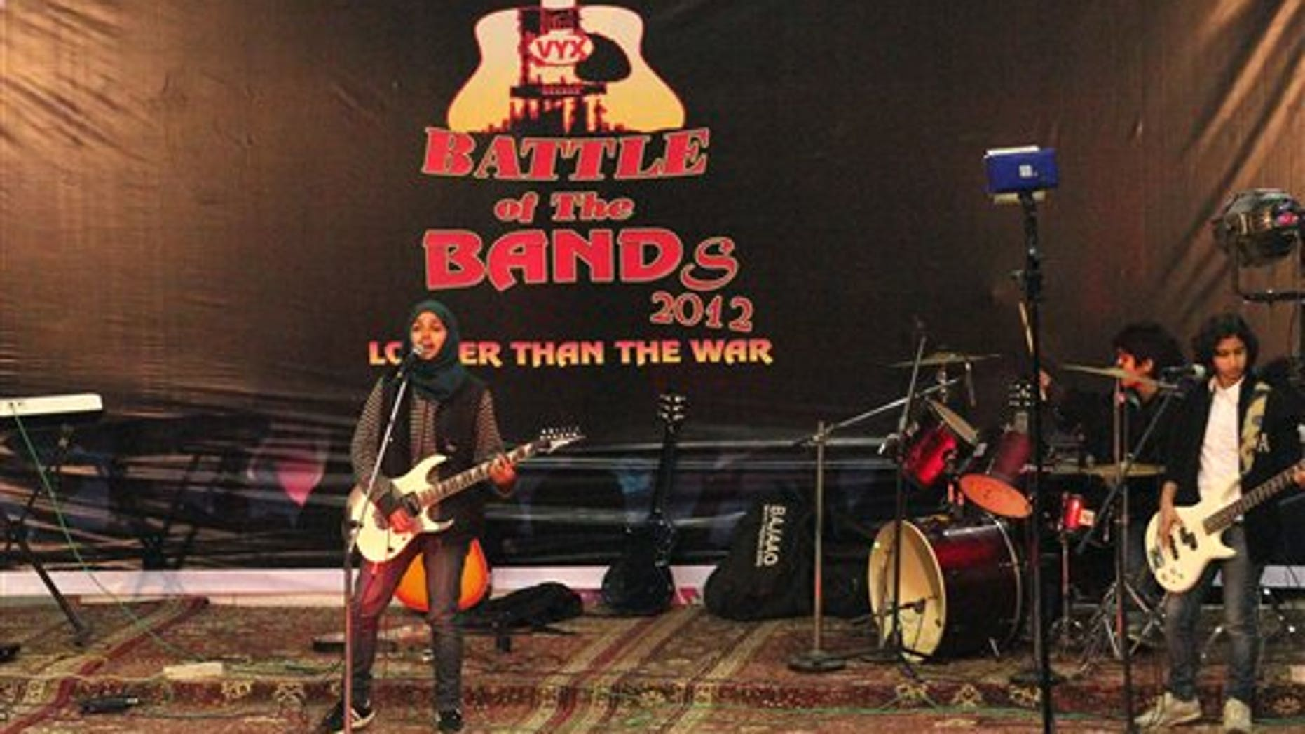 In this Sunday, Dec. 23, 2012 photo, members of Indian-controlled Kashmirs first all-girl rock band Pragaash, or First Light, perform at the annual Battle of the Bands in Srinagar, India.