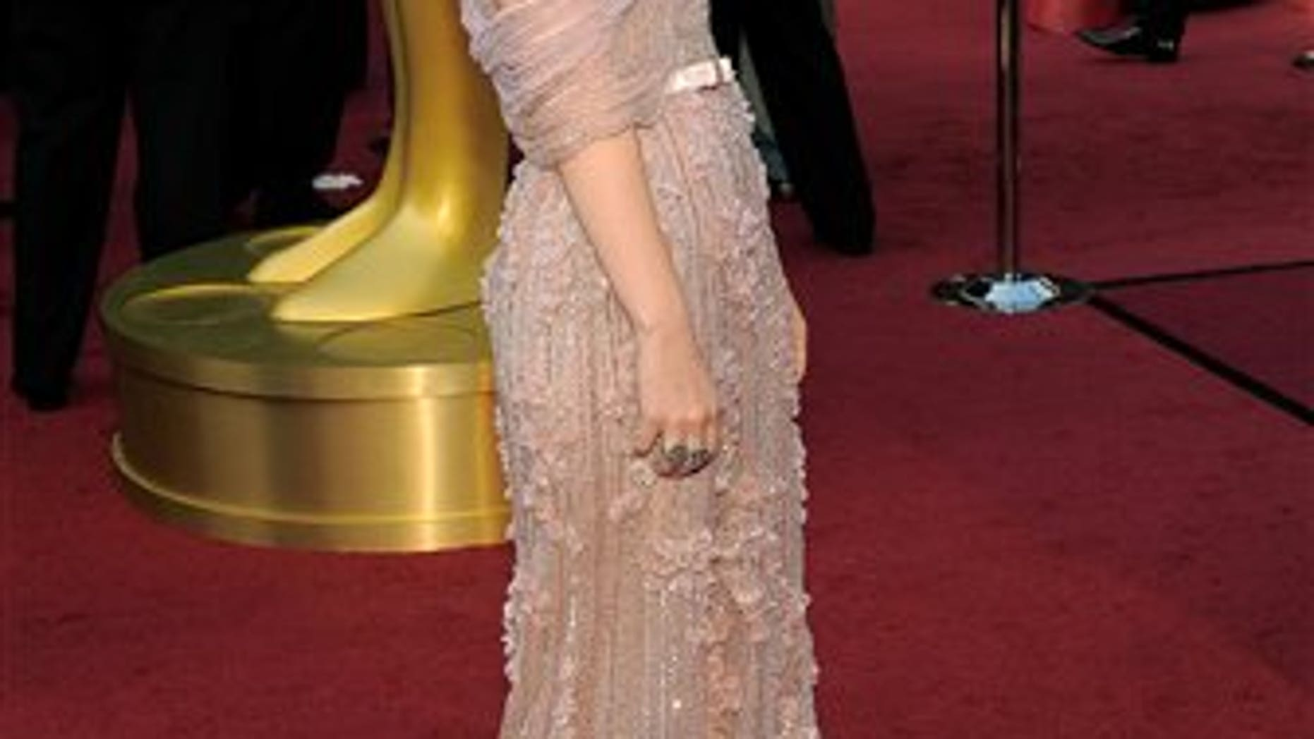 Kate Mara arrives before the 84th Academy Awards on Sunday, Feb. 26, 2012, in the Hollywood section of Los Angeles. (AP Photo/Chris Pizzello)