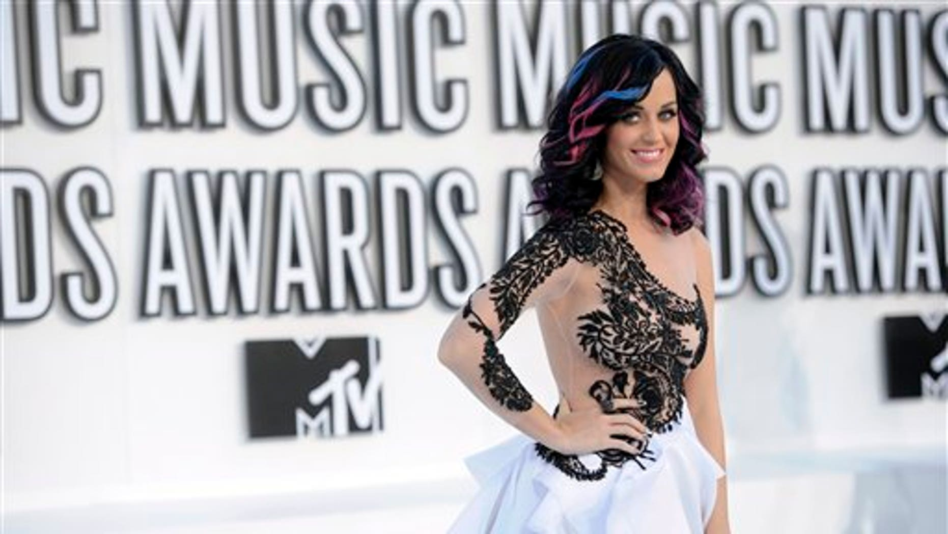 Katy Perry arrives at the MTV Video Music Awards on Sunday, Sept. 12, 2010 in Los Angeles. (AP Photo/Chris Pizzello)
