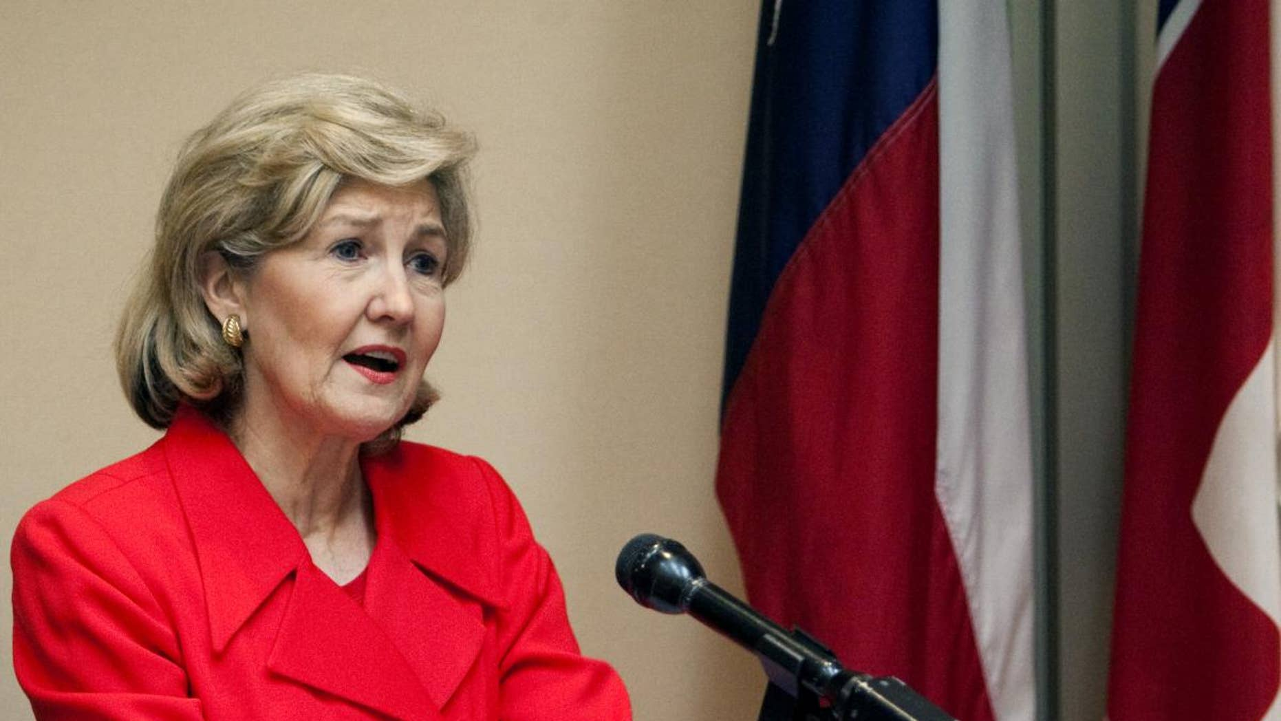 FILE - In this Jan. 19, 2010, file photo Sen. Kay Bailey Hutchison, R-Texas, addresses the Greater Houston Pachyderm Club in Houston. Hutchison announced Thursday, Jan. 13, 2011, that she will retire after her current term expires next year. (AP Photo/Bob Levey, File)
