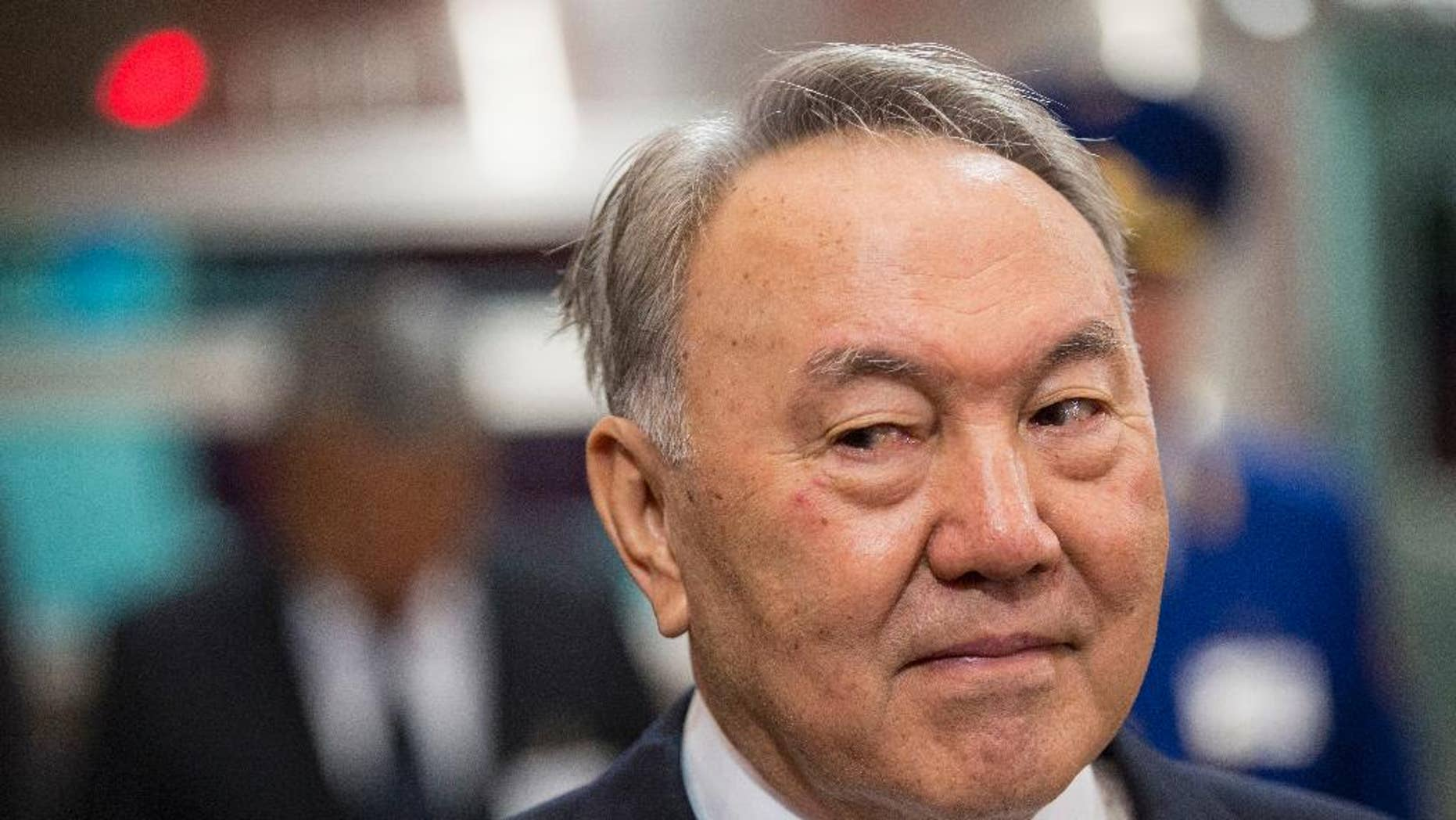 """FILE - In this Saturday, April 18, 2015 file photo, Kazakhstan's President and the main presidential candidate Nursultan Nazarbayev is seen during the opening of the """"Moscow"""" subway station of the Almaty metro system in Almaty, Kazakhstan. As oil-rich Kazakhstan votes for a president Sunday, April 26, 2015, the governing elite is pounding home a mantra of stability as fears percolate about the country's massive Russian minority taking inspiration from the Moscow-backed insurgency in Ukraine.With authorities clamping down on all opposition, Nursultan Nazarbayev's re-election is a done deal. The former Communist party boss' two rivals - a trade union leader and a Communist politician- have negligible public profiles and are standing only to create the illusion of competition. (AP Photo/Pavel Mikheyev, file)"""