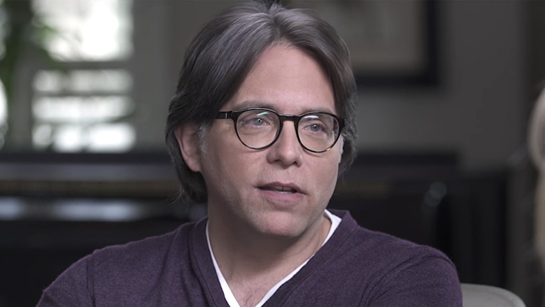 """Known to his followers as """"Vanguard,"""" Raniere is accused of masterminding and overseeing a system in which women were told the best way to advance was to become a """"slave"""" overseen by """"masters."""""""