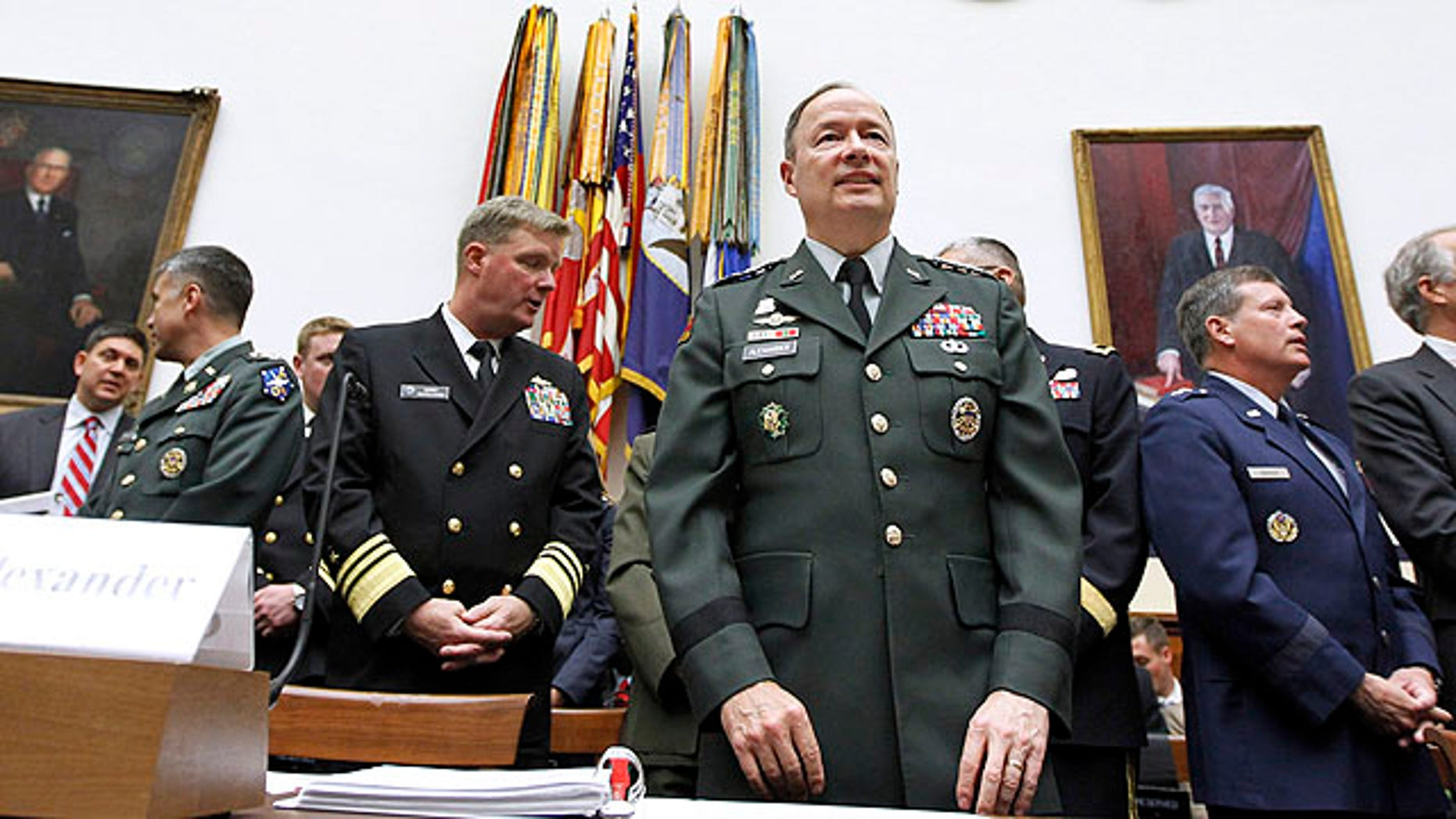 Sept. 23, 2010: Army Gen. Keith B. Alexander, commander of the U.S. Cyber Command, center, arrives on Capitol Hill in Washington to testify before the House Armed Services Committee hearing on cyberspace operations.