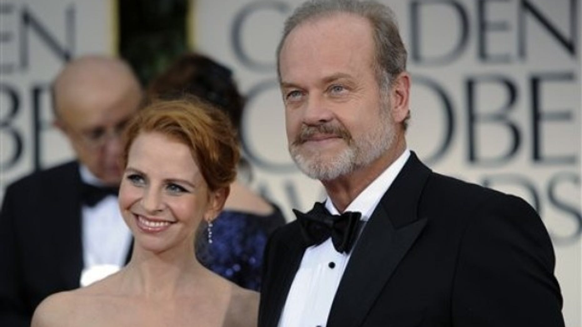 Kelsey Grammer and his wife Kayte Walsh arrive at the 69th Annual Golden Globe Awards Sunday, Jan. 15, 2012, in Los Angeles. (AP Photo/Chris Pizzello)