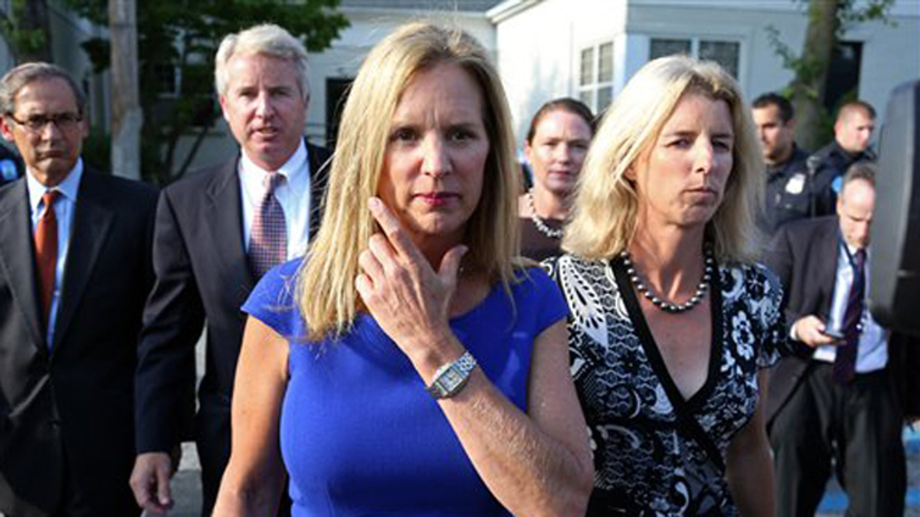 July 17, 2012: Kerry Kennedy, ex-wife of New York Gov. Andrew Cuomo, flanked by her brother Christopher Kennedy, center left, and sister Rory Kennedy, right, walks from  the North Castle Justice Court in Armonk, N.Y.