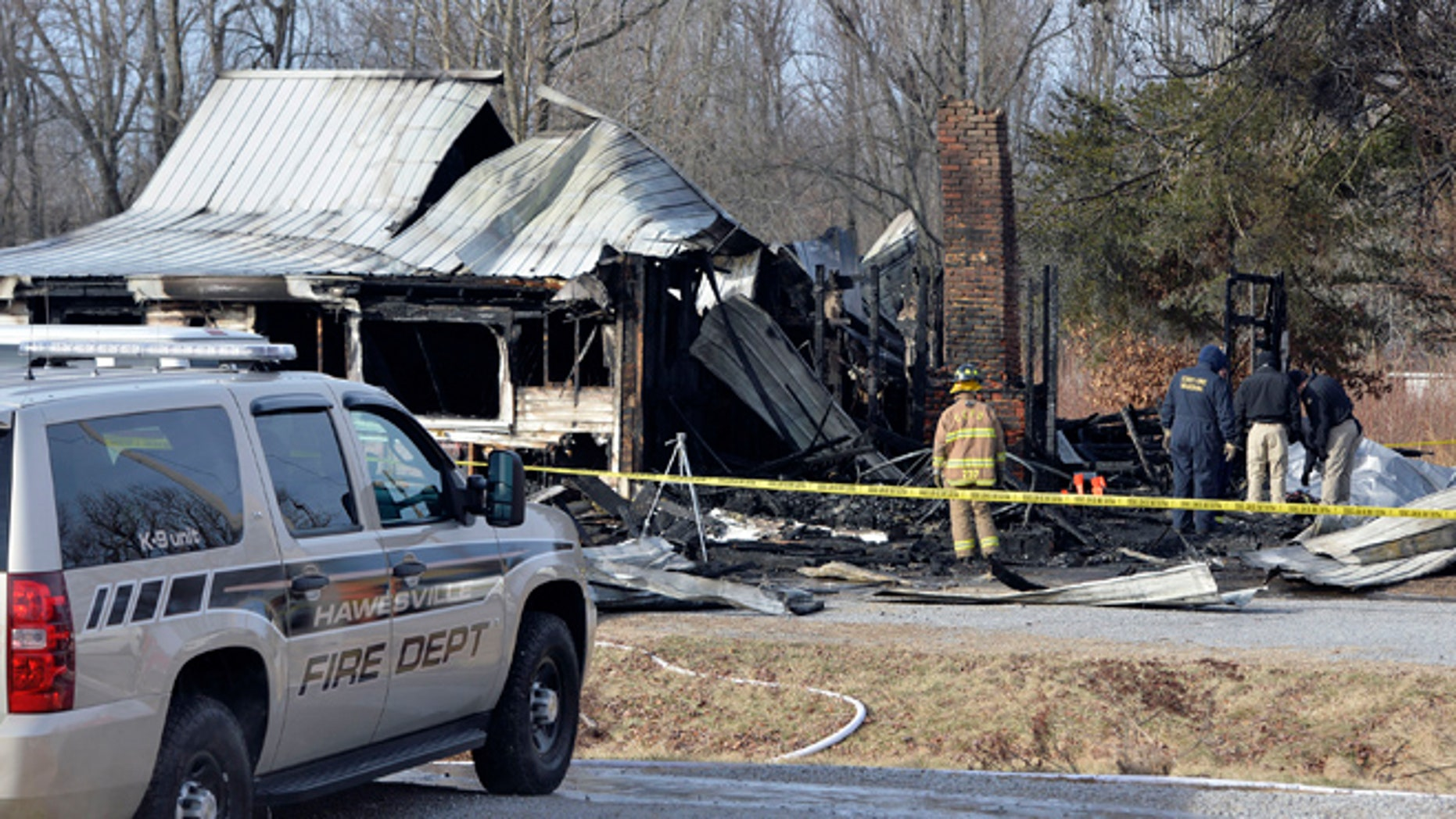 Jan. 30: Members of the Kentucky State Fire Marshall's office look over the remains of a house fire in Depoy, Ky.