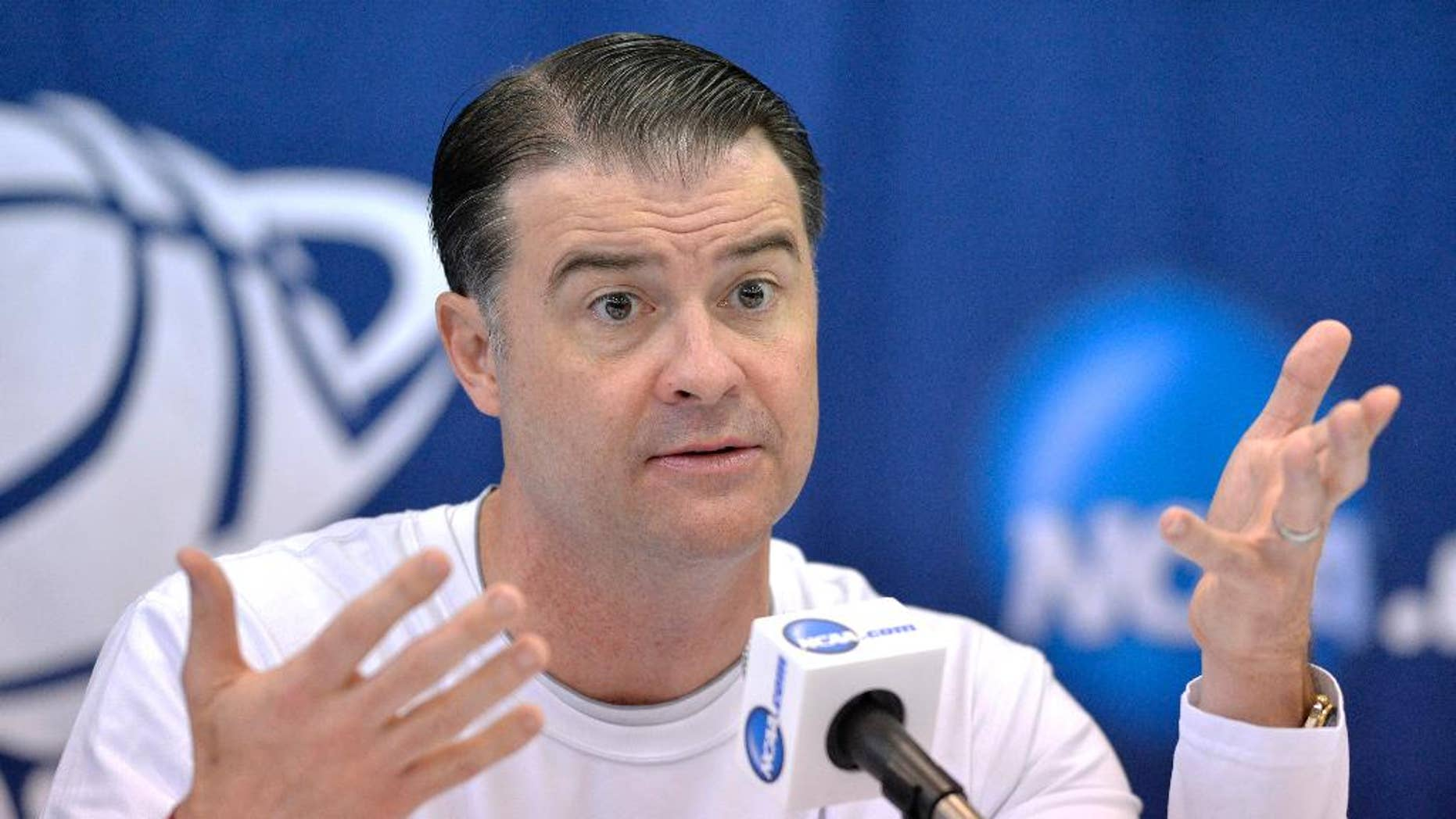 FILE - In this March 23, 2014, file photo, Kentucky head coach Matthew Mitchell answers questions at a news conference for the NCAA women's college basketball tournament in Lexington, Ky. Mitchell begins the season cautioning against expecting too much initially from a Wildcats team that lost forwards DeNesha Stallworth and Samarie Walker. (AP Photo/Timothy D. Easley, File)