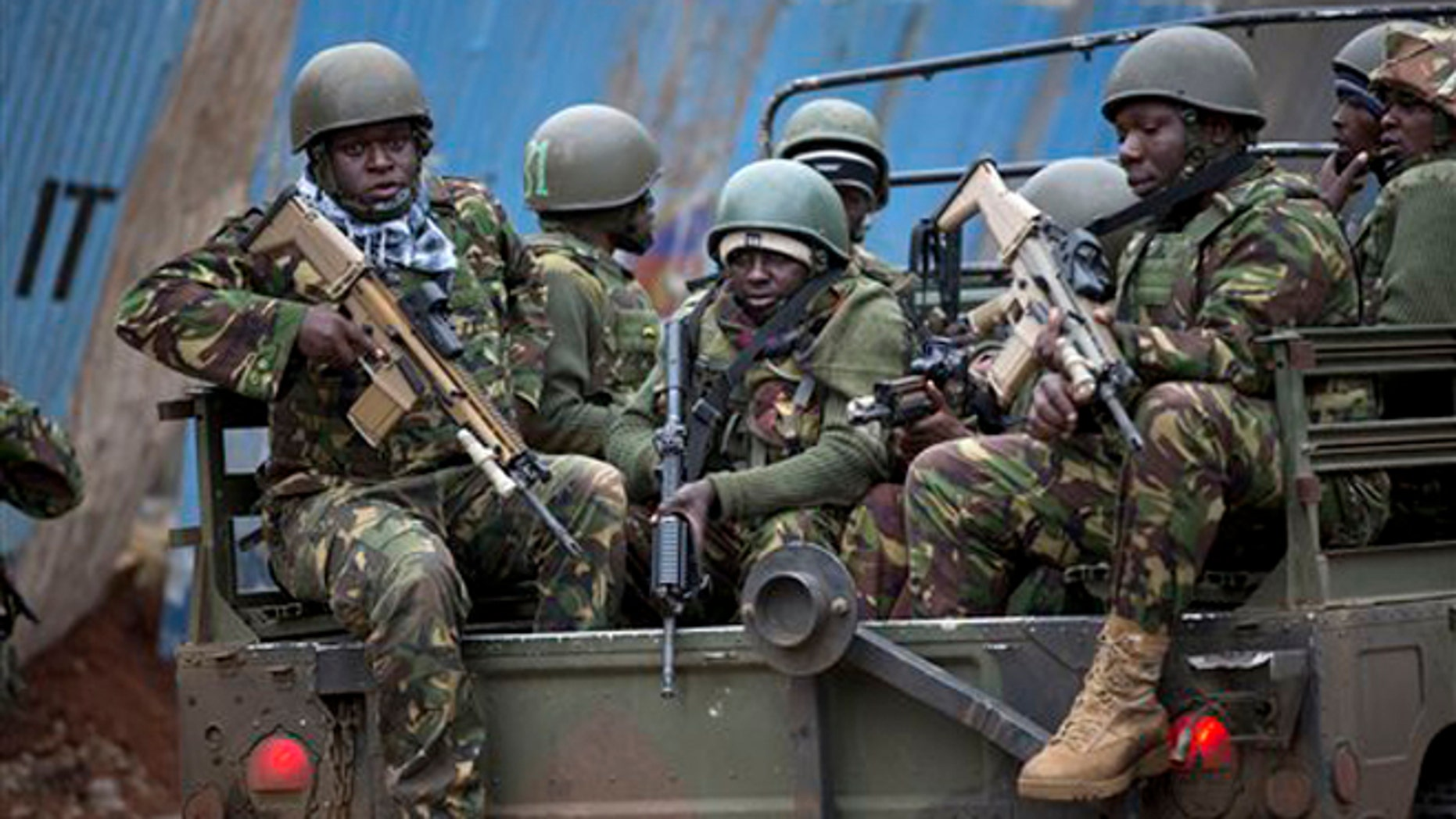 Trucks of soldiers from the Kenya Defense Forces arrive after dawn outside the Westgate Mall in Nairobi, Kenya Sunday, Sept. 22, 2013. Islamic extremist gunmen lobbed grenades and fired assault rifles inside Nairobi's top mall Saturday, killing dozens and wounding over a hundred in the attack. Early Sunday morning, 12 hours after the attack began, gunmen remained holed up inside the mall with an unknown number of hostages. (AP Photo/Ben Curtis)