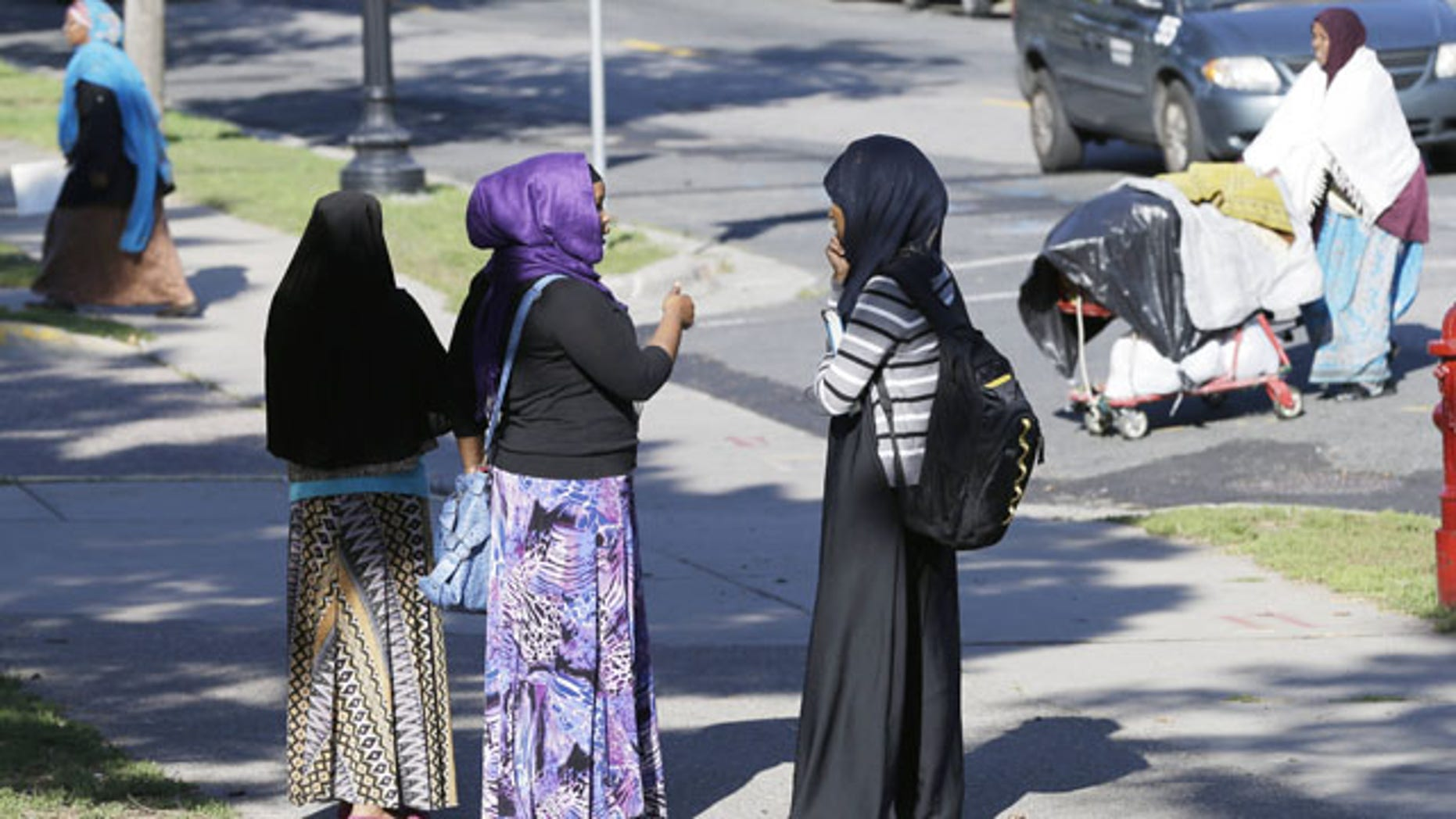 September 24, 2013: Members of the Somali community visit near a park in Minneapolis. It's been six years since Minnesota first began furnishing young fighters to al-Shabab, the terror group that has claimed responsibility for the deadly mall attack in Kenya. (AP Photo)