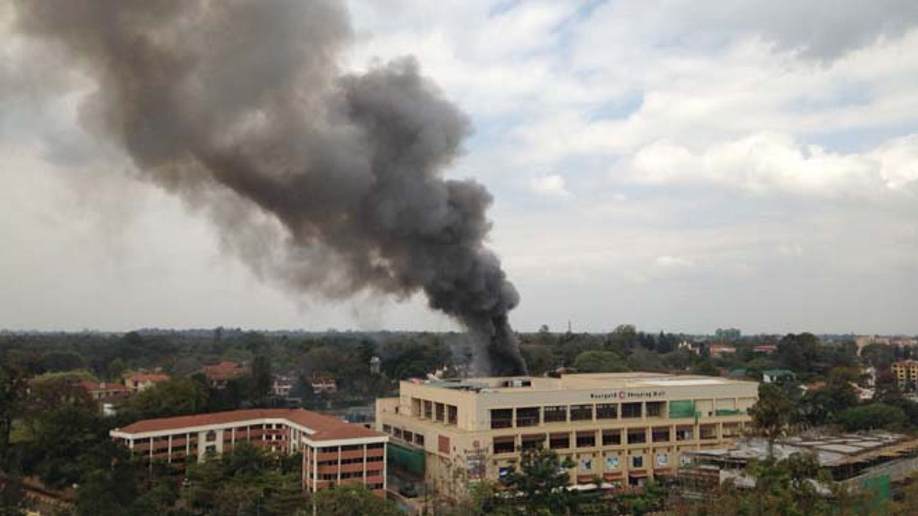 Sept. 23, 2013: In this file photo, heavy smoke rises after multiple large blasts rocked the Westgate Mall in Nairobi, Kenya. (AP)