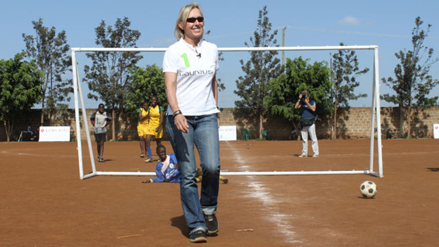 Tennis great Martina Navratilova celebrates after scoring a goal during a demonstration at a soccer game in Nairobi, Kenya on Saturday, Dec. 4, 2010. Navratilova next week will climb Tanzania's Mount Kilimajaro to raise money and awareness for the Laureus Sport for Good Foundation.