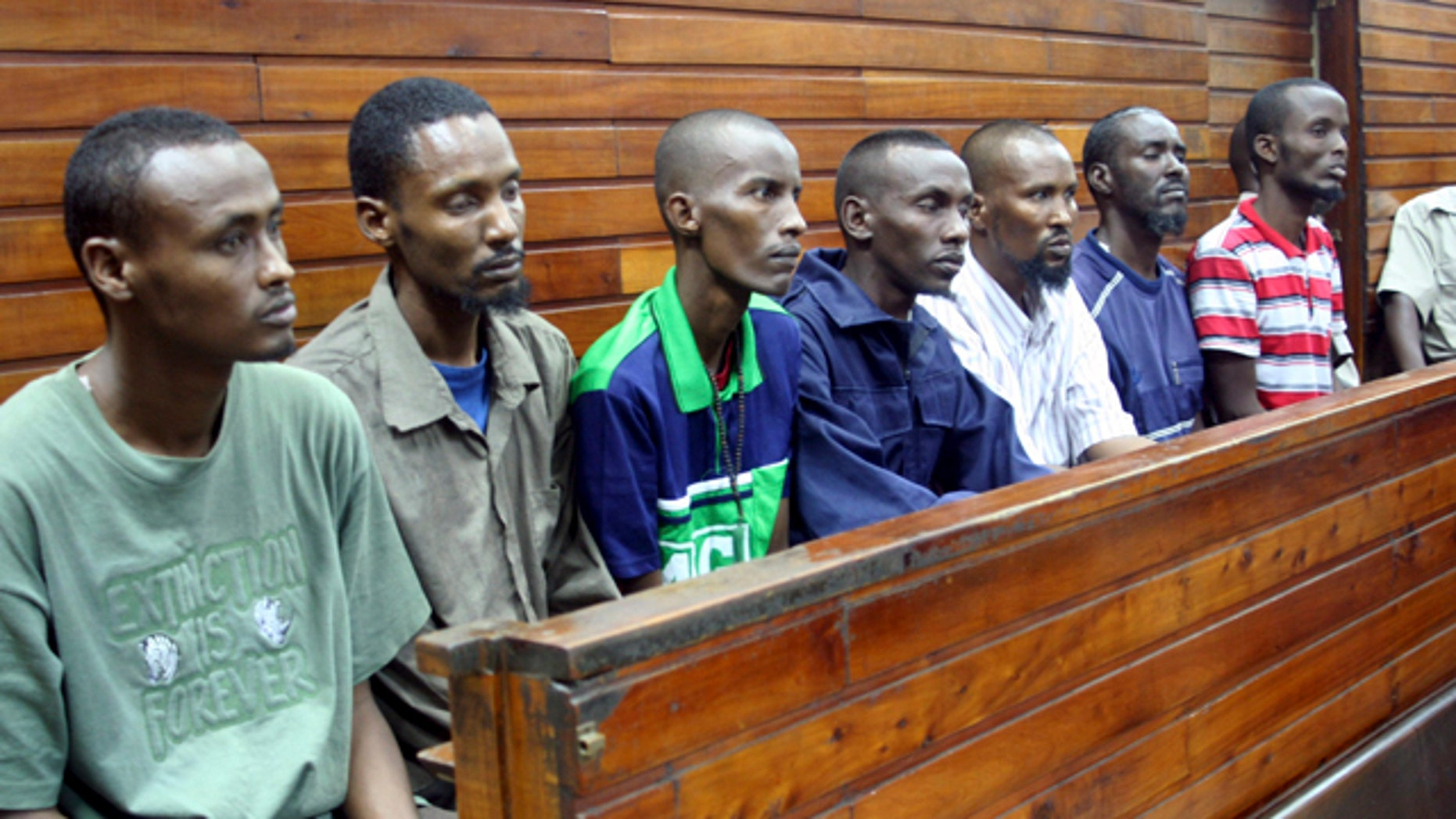September 6: The seven suspected Somali pirates sit in the dock at the Mombasa Law courts in Kenya, as the Mombasa Chief Magistrate Rosemelle Motoka read her judgement. (AP)