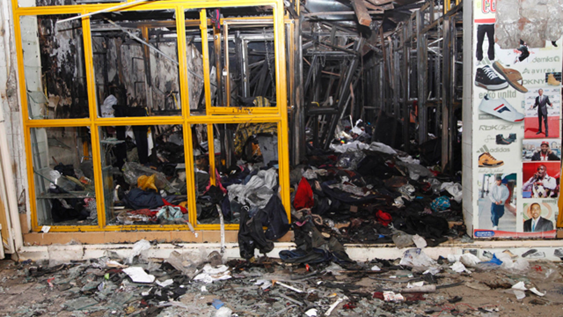 May 29: Destroyed shop after an explosion in downtown Nairobi. The explosion ripped through a building, injuring at least 33 people, including a woman who blamed the blast on a 'bearded man' who left behind a bag shortly before the detonation.