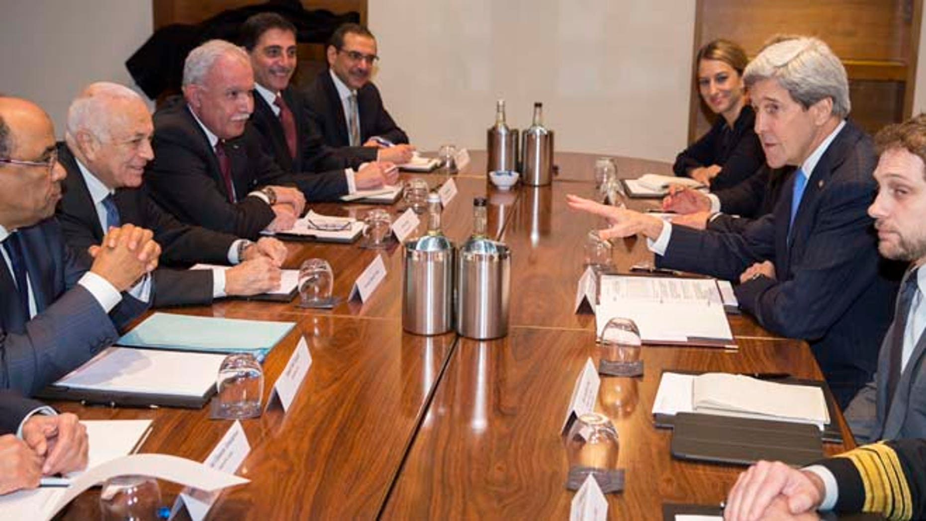 US Secretary of State John Kerry, second right, meets with Arab League secretary general Nabil El-Arabi, second from left, on Tuesday, Dec. 16, 2014, in London.