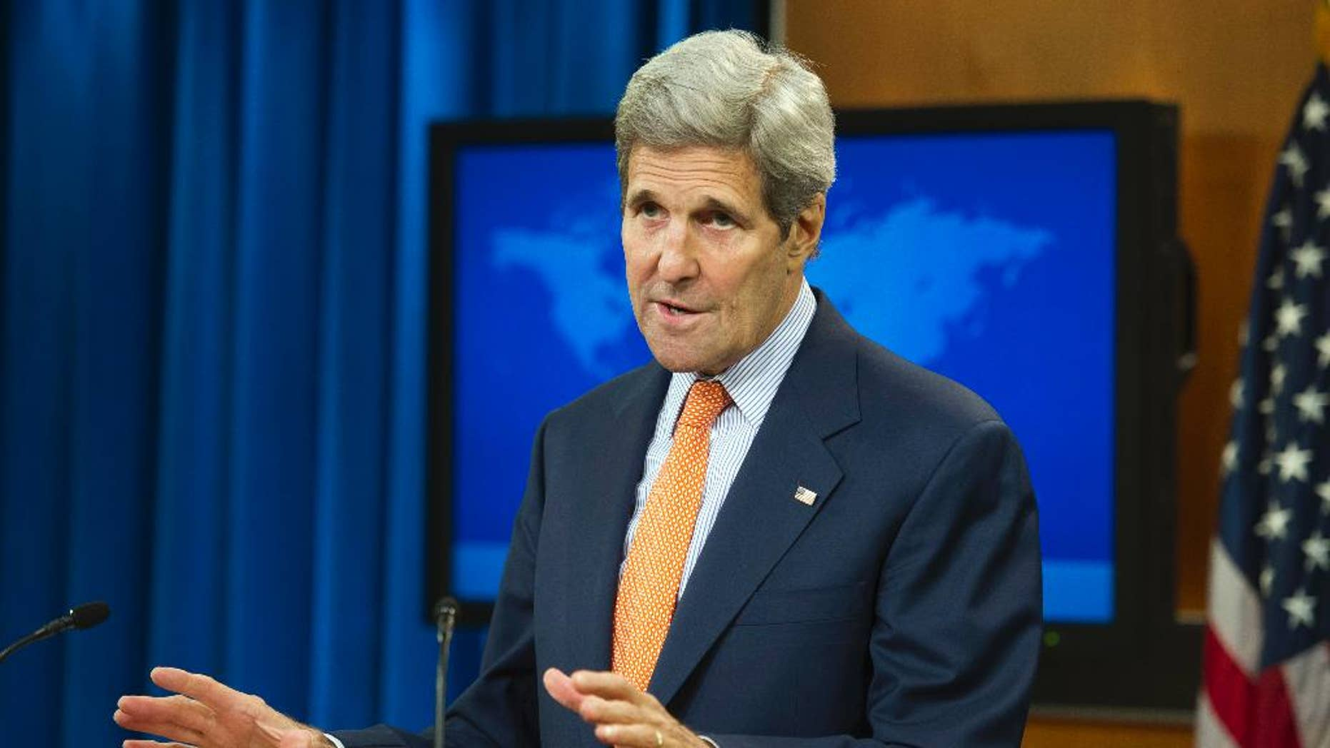 Secretary of State John Kerry speaks at the State Department in Washington, Thursday, June 25, 2015, to release it's annual human rights reports. The Obama administration has once again identified Iran and Cuba as serial human rights abusers even as it accelerates attempts to improve relations with both countries. (AP Photo/Cliff Owen)