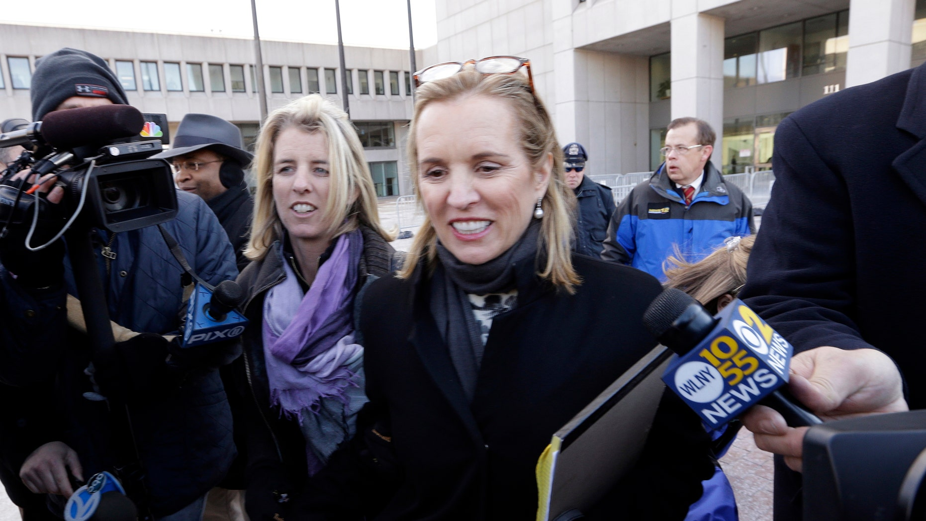 FILE - In this Feb. 26, 2014 file photo, Kerry Kennedy, center, leaves Westchester County courthouse with Rory Kennedy, left, in White Plains, N.Y.  Kennedy was acquitted Friday, Feb. 28, 2014,  of drugged driving after she accidentally took a sleeping pill and then sideswiped a truck in a wild highway drive she said she didn't remember. Kennedy hugged and clasped hands with her lawyers as a six-person jury cleared her of driving while impaired, a misdemeanor. (AP Photo/Frank Franklin II)