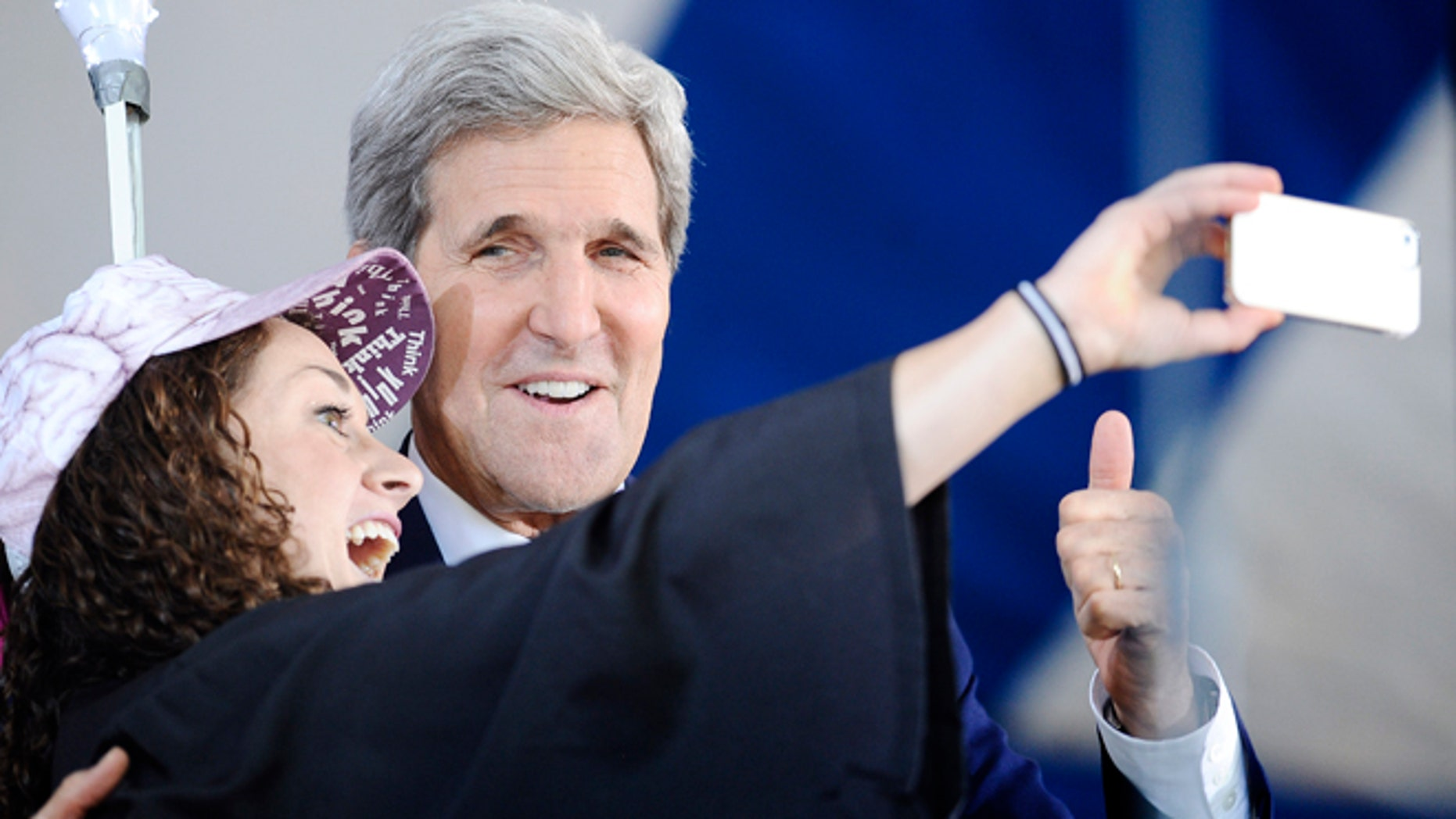Secretary of State John Kerry, right poses for a selfie with Yale student Ariel Kirshenbaum during Class Day at Yale University, Sunday, May 18, 2014, in New Haven, Conn. (AP Photo/Jessica Hill)
