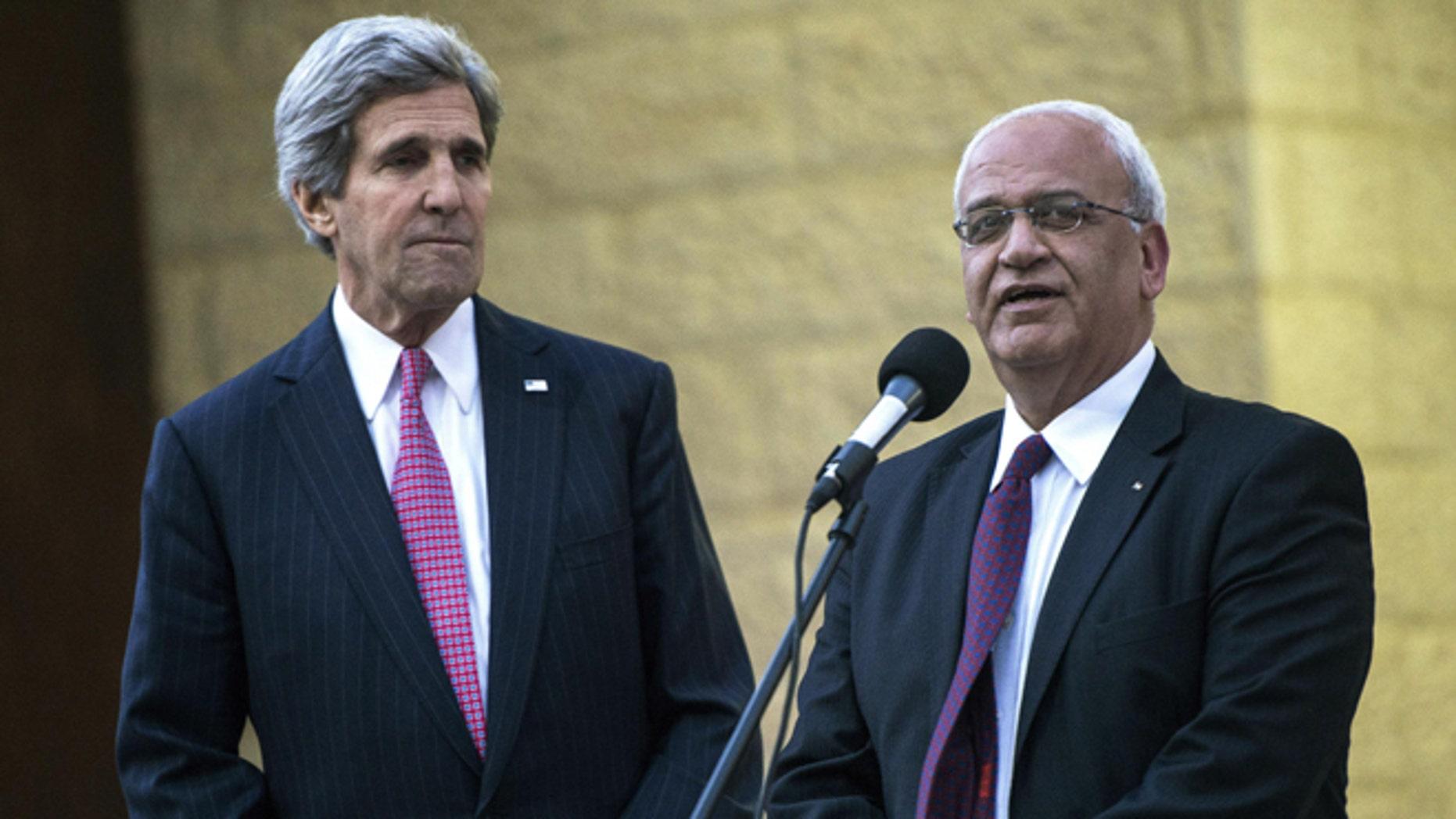 Jan. 4, 2014: Secretary of State John Kerry, left, and Palestinian negotiator Saeb Erekat at the Palestinian in the West Bank city of Ramallah.
