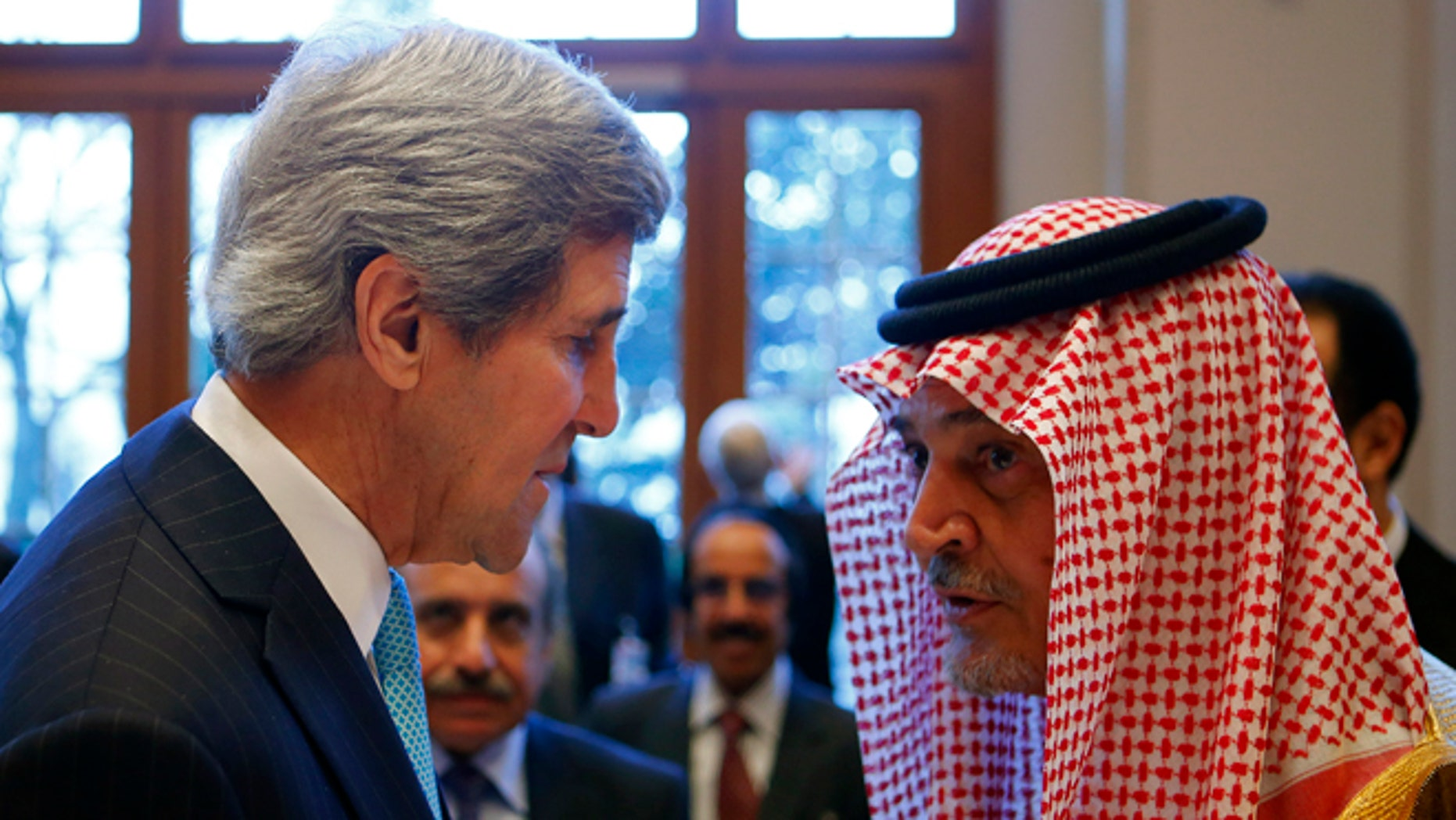 Jan. 22, 2014: Secretary of State John Kerry talks to Saudi Arabia's Foreign Minister Prince Saud al-Faisal in Montreux, Switzerland.