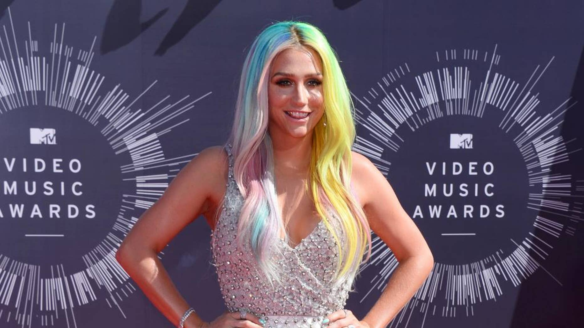 FILE - In this Aug. 24, 2014 file photo, Kesha arrives at the MTV Video Music Awards at The Forum in Inglewood, Calif. Attorneys for music producer Lukasz Gottwald, known professionally as Dr. Luke, filed a motion in Los Angeles Superior Court on Monday, Nov. 17, 2014, seeking the dismissal of claims made by the pop singer, Kesha, that she was raped by her mentor. Gottwald's filings argue that the claims are barred by the statue of limitations. (Photo by Jordan Strauss/Invision/AP, File)