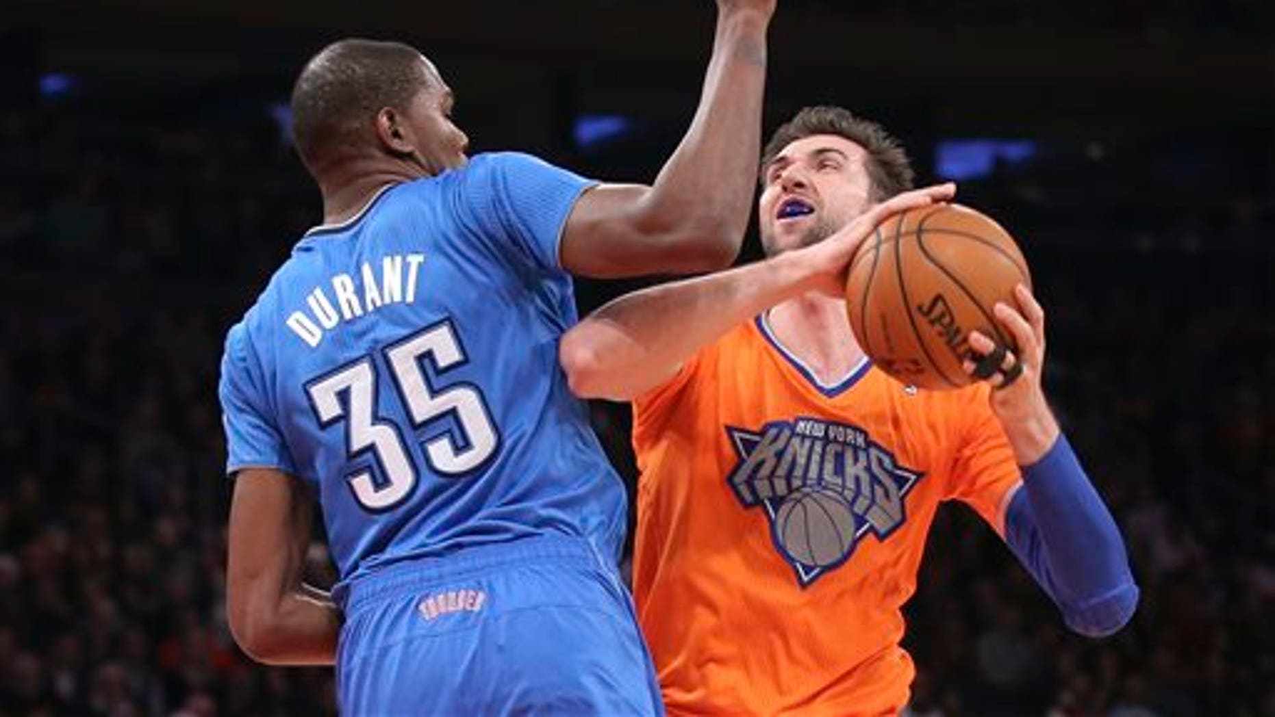 Knicks' Andrea Bargnani shoots against Oklahoma City Thunder's Kevin Durant at Madison Square Garden, Wednesday, Dec. 25, 2013, in New York.