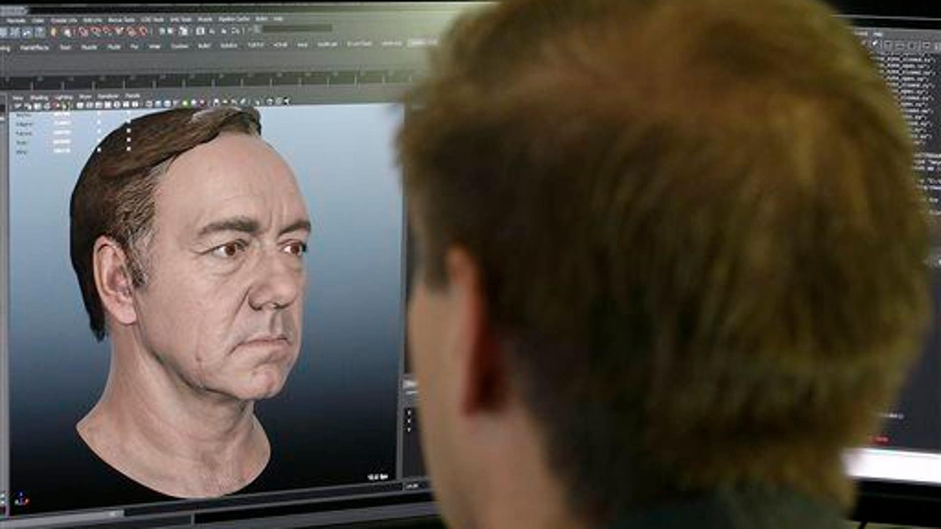 "This July 31, 2014, photo shows a senior technical artist working on the face of actor Kevin Spacey for the new ""Call of Duty: Advanced Warfare"" game at Sledgehammer Games in Foster City, Calif."