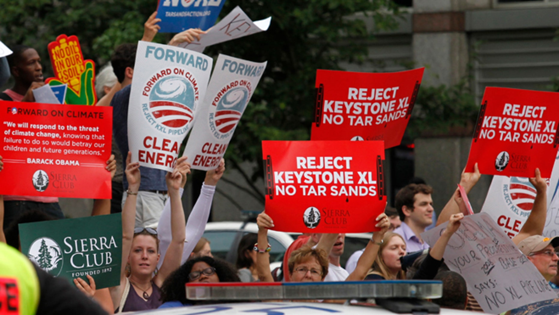 FILE: July 11, 2013: Protesters rally about the Keystone XL oil pipeline, in Washington, D.C.
