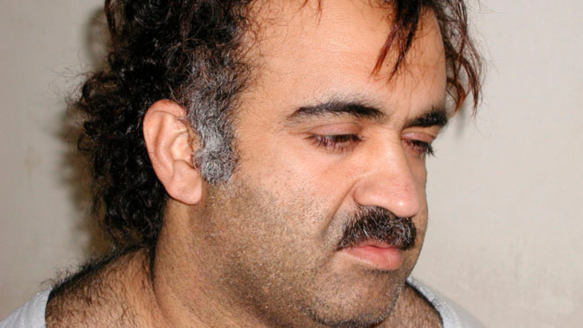 Khalid Sheikh Mohammed is shown in this file photograph during his arrest on March 1, 2003.